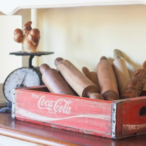 Vintage Coca-Cola Crate filled with Antique Rolling Pins - Part of a farmhouse style display on a kitchen hutch. virginiasweetpea.com