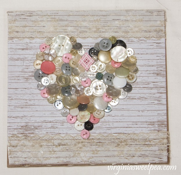 DIY Valentine's Day Button Heart - Vintage buttons were used to create this heart. #vintagebuttons #vintage #valentinesday #craftidea #buttoncraft