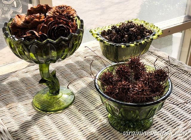 St. Patrick's Day Vignette - Pine Cones and Sweet Gum Balls in Vintage Green Vases - virginiasweetpea.com #stpatricksday #stpatricksdaydecor
