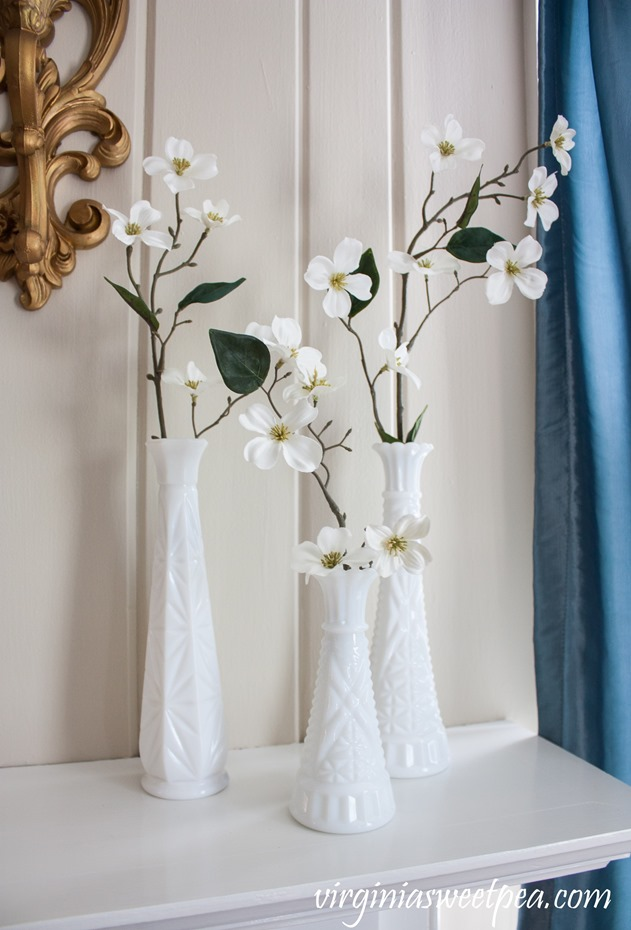 Vintage Milk Glass with spring blooms on a decorated for spring mantel. #spring #springdecor #springmantel #vintage #vintagedecor