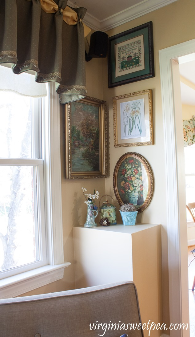 Living Room Corner decorated for spring with floral prints, vintage bird decor, and a McCoy vase. #springdecorating #vintagedecor #hometour #springhometour #styledforspring #vintagedecor