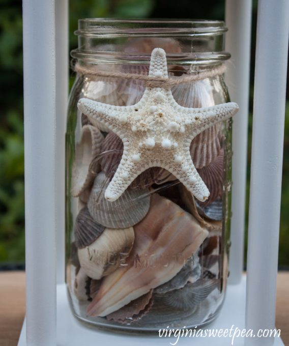 Mason Jar Filled with Shells used for Summer Decor in a DIY Lantern #DIYLantern #masonjar #summerdecor