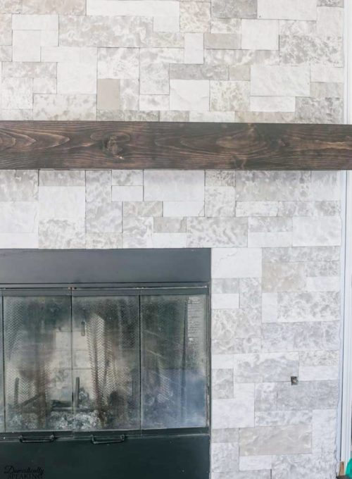 How to Build Your Own Rustic Fireplace Mantel - Learn how to make a rustic fireplace mantel for your home. #diymantel #diyrusticmantel #woodworking