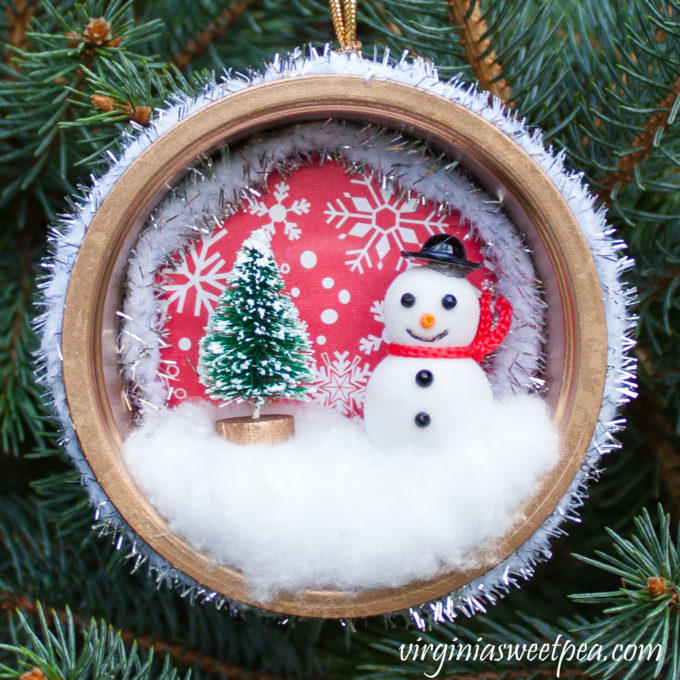 Handmade Winter Wonderland Christmas Ornament - You'll never guess what was upcycled to make this pretty ornament! #christmascraft #handmadechristmas #decoratethetree #christmastreeornaments #christmastreeideas