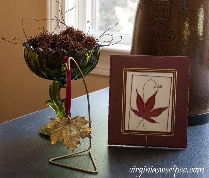 Vintage Fall Decor in the Family Room - A fall vignette using both vintage and new items.