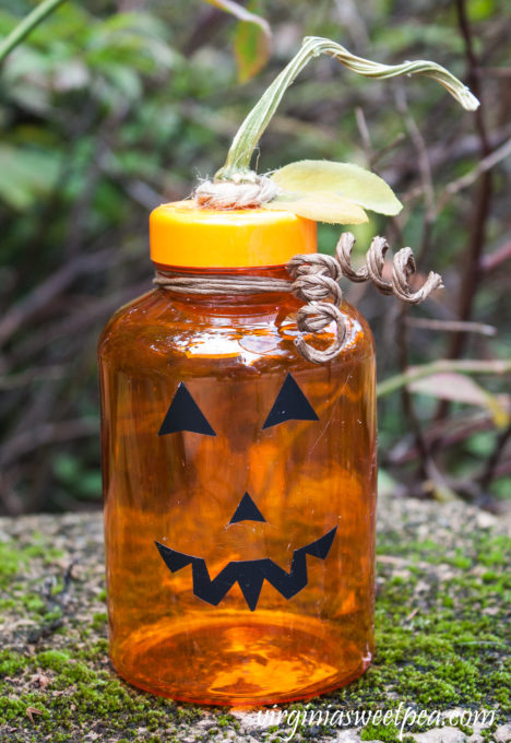 Use an Upcycled Medicine Bottle to Make a Jack-o-Lantern for Halloween decor. #halloween #halloweencraft #upcycle #craftidea