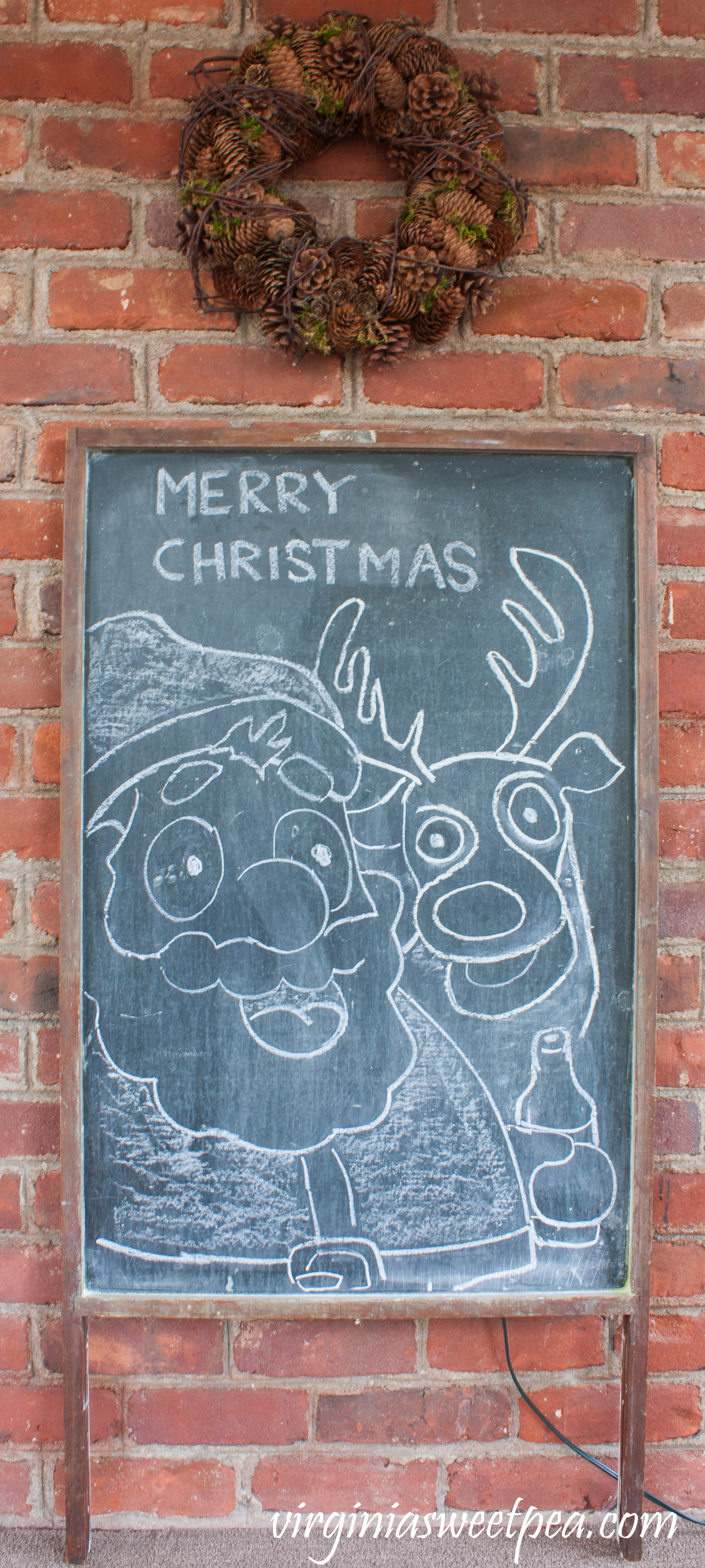 Chalk art featuring Santa enjoying a cold one with Rudolph on an antique chalkboard. #chalkart #christmaschalkart #vintage #christmas