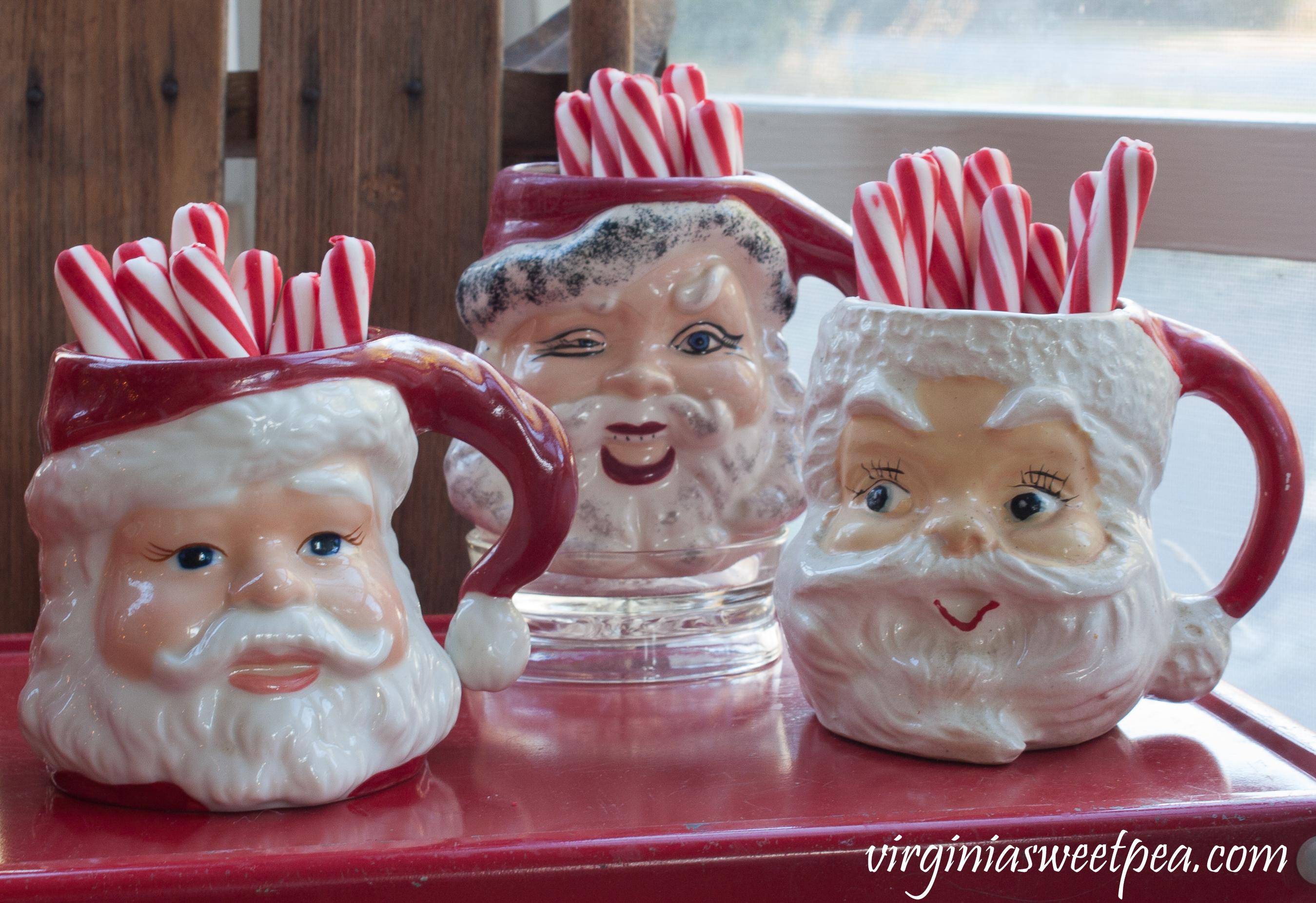 Christmas Porch Vignette - Vintage Santa mugs. #christmas #christmasdecorations #christmasporch #vintage #vintagechristmas