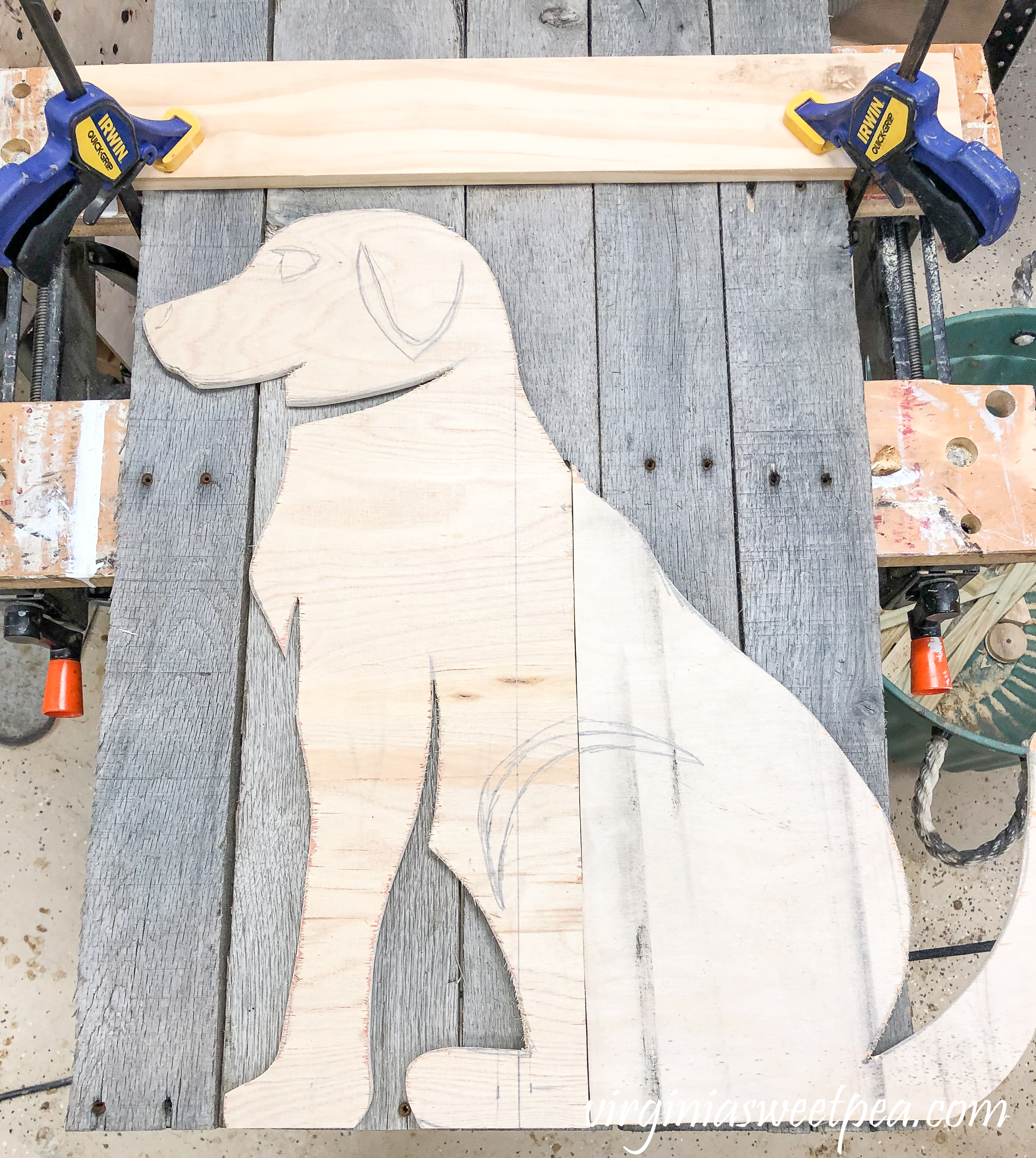 How to Make a Pallet Wood Dog - Silhouette of a dog on pallet wood ready to be cut out.