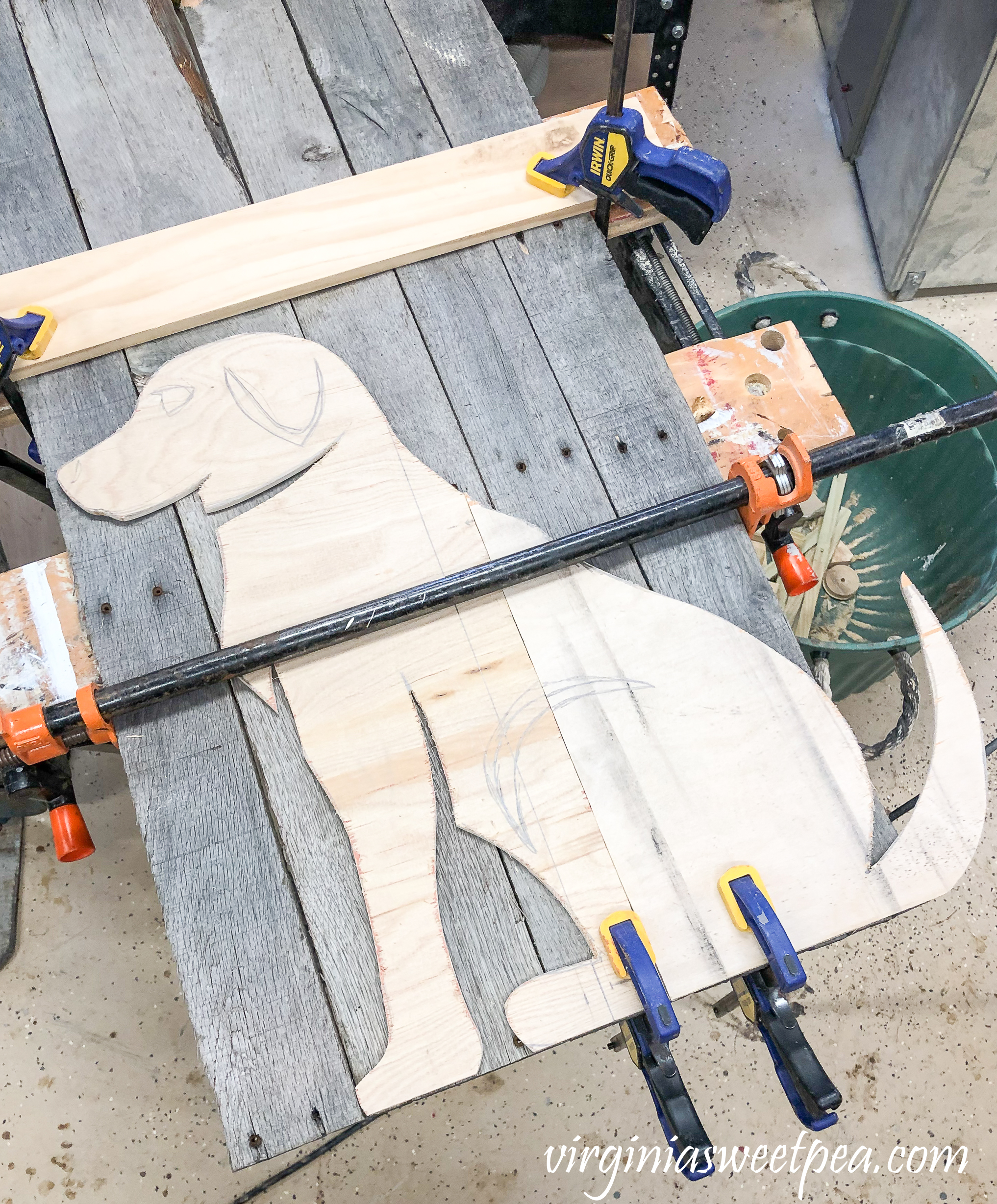 Steps to Make a Pallet Wood Dog - Trace the dog template onto the pallet wood.