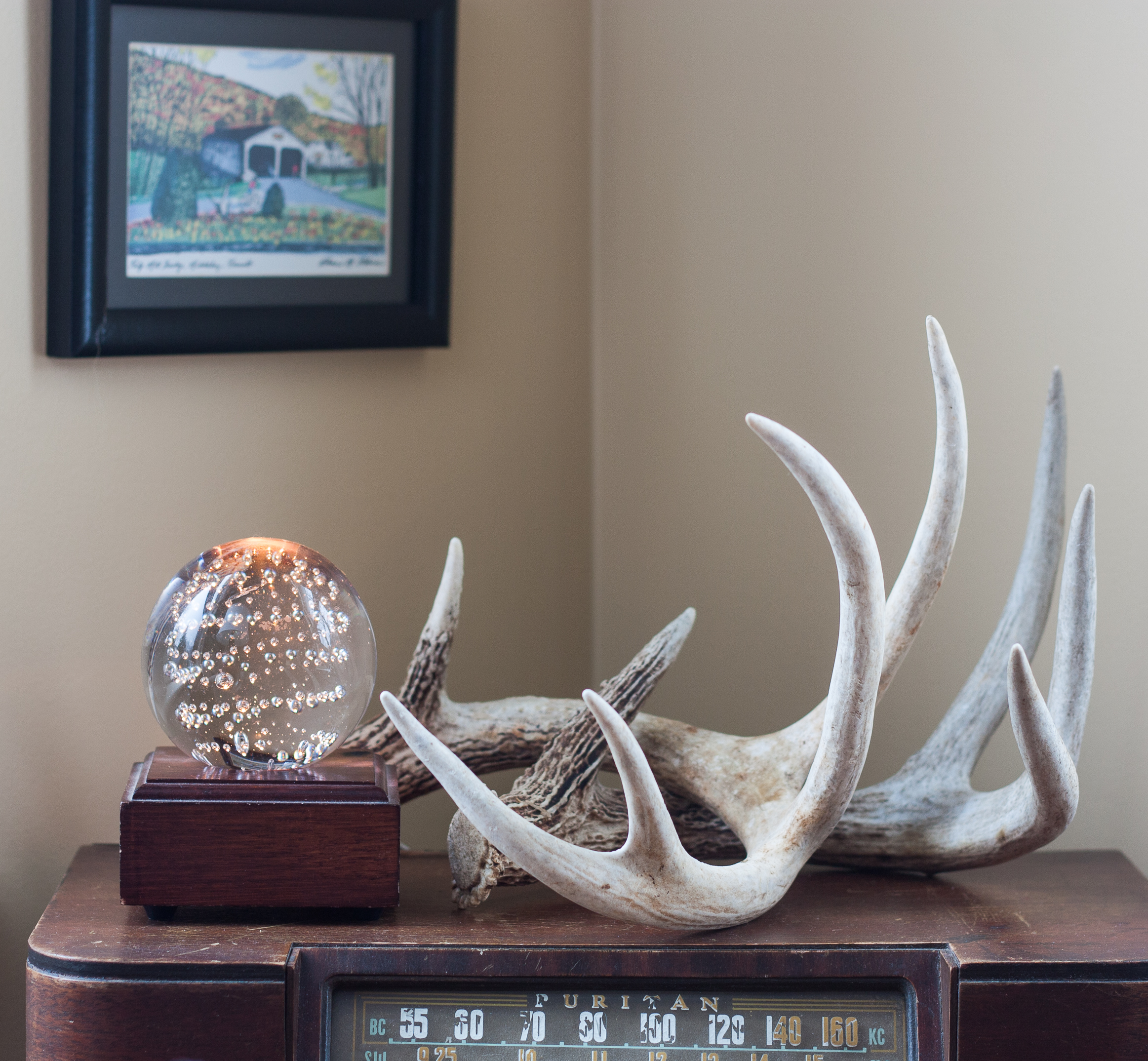 Cozy Winter Decor - Antlers and a lighted glass globe. #cozy #winterdecor #deerantlers