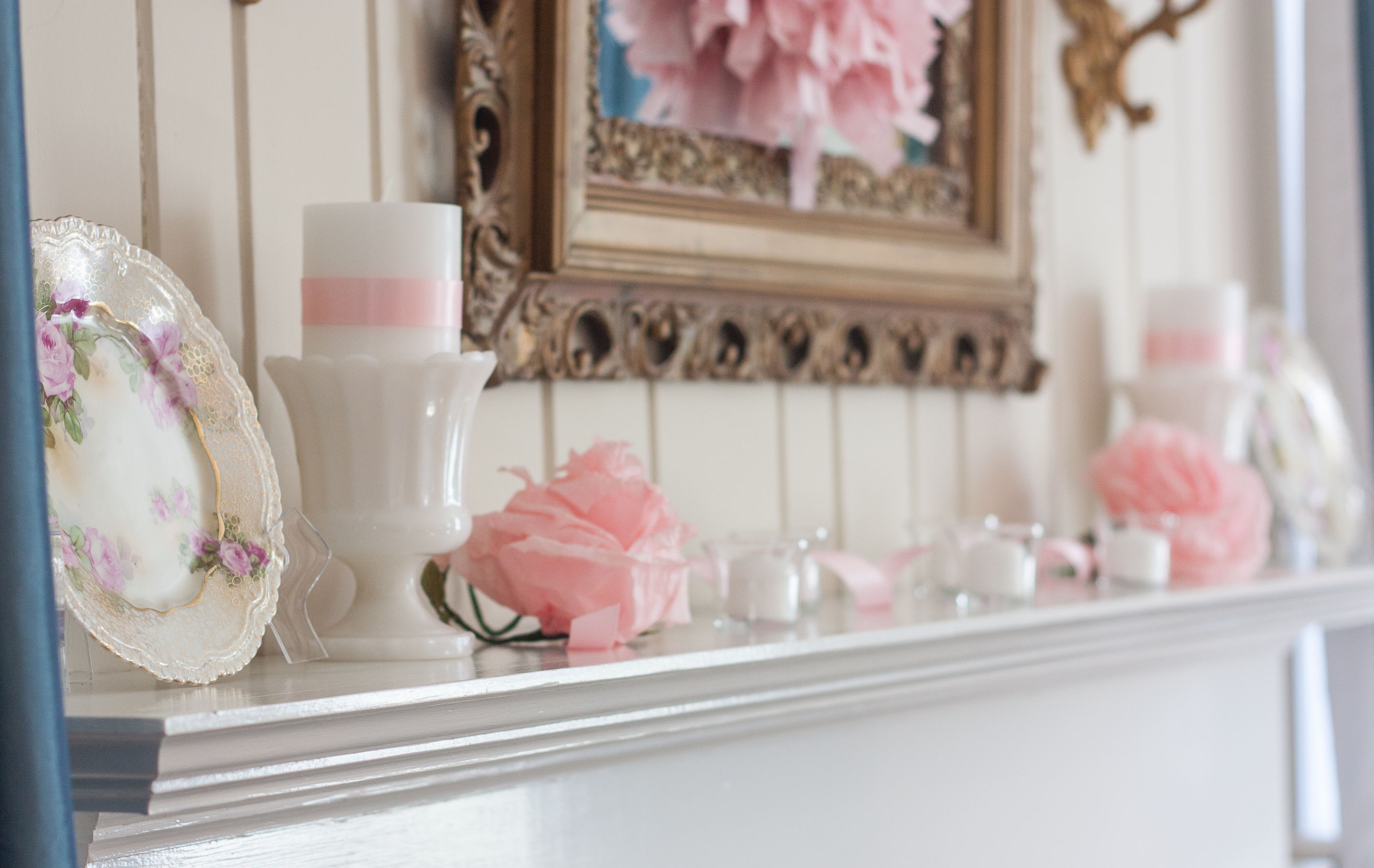 Romantic and Vintage Valentine's Day Mantel - See a mantel decorated with antique floral plates, milk glass, crepe paper flowers, and votives filled with white candles. #valentinesday #valentinesdaydecor #romantic #romanticdecor #vintage #vintagedecor