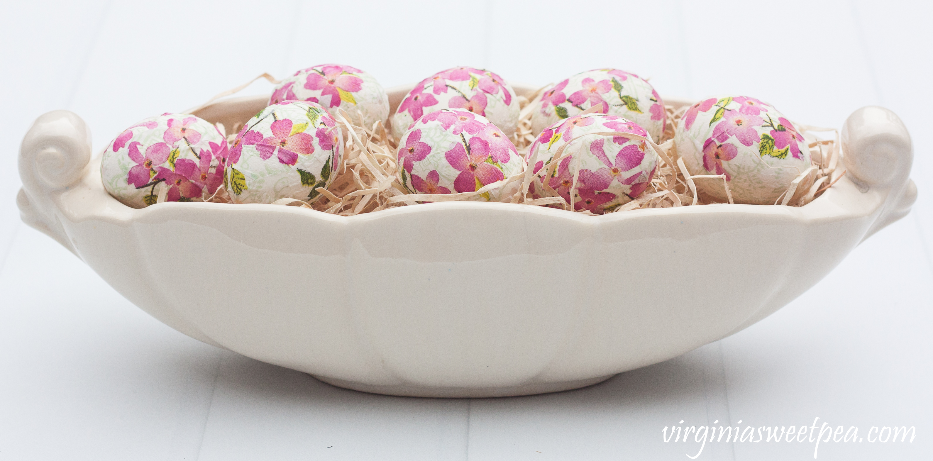 Eggs decoupaged with Caspari napkins in Blooming Branches arranged in a vintage Abingdon Pottery console bowl in the Fern Leaf pattern