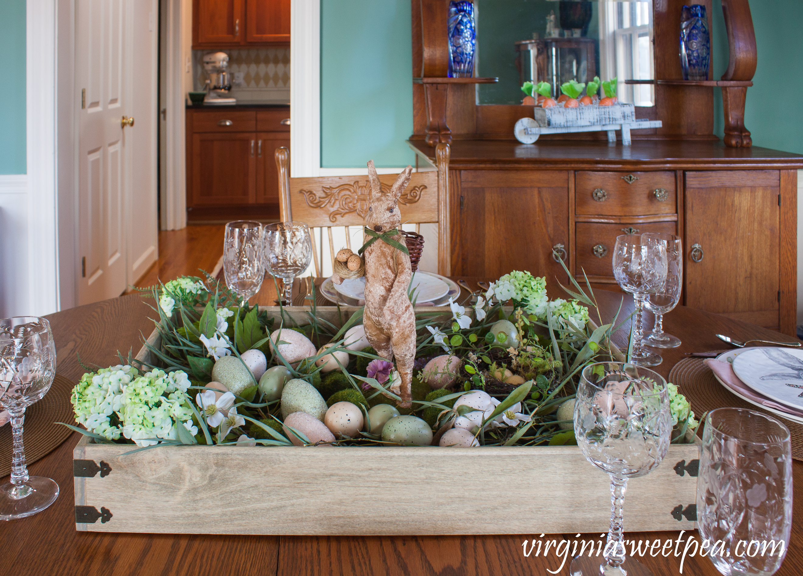 Farmhouse Style Easter Centerpiece - Learn how to copy this look for your own Easter table. #easter #eastercenterpiece #eastertablescape #farmhouse #farmhousecenterpiece #farmhousetable #eastertable