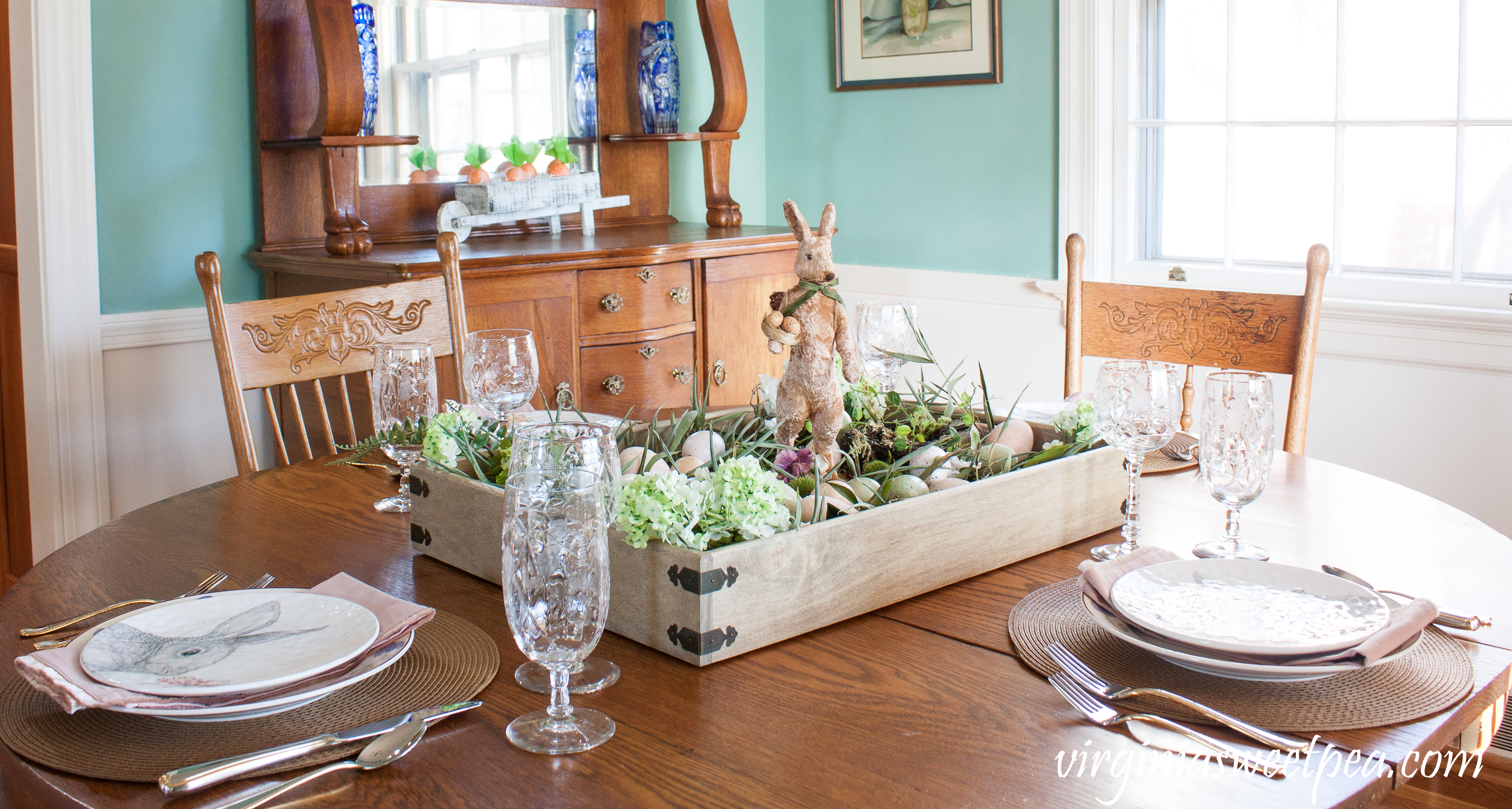 Farmhouse Style Easter Centerpiece and Easter Tablescape - Farmhouse Style Easter Centerpiece & Table - Get ideas for making a farmhouse style Easter centerpiece and ideas for table decor for your Easter table. #easter #eastercenterpiece #eastertablescape #farmhouse #farmhousecenterpiece #farmhousetable #eastertable
