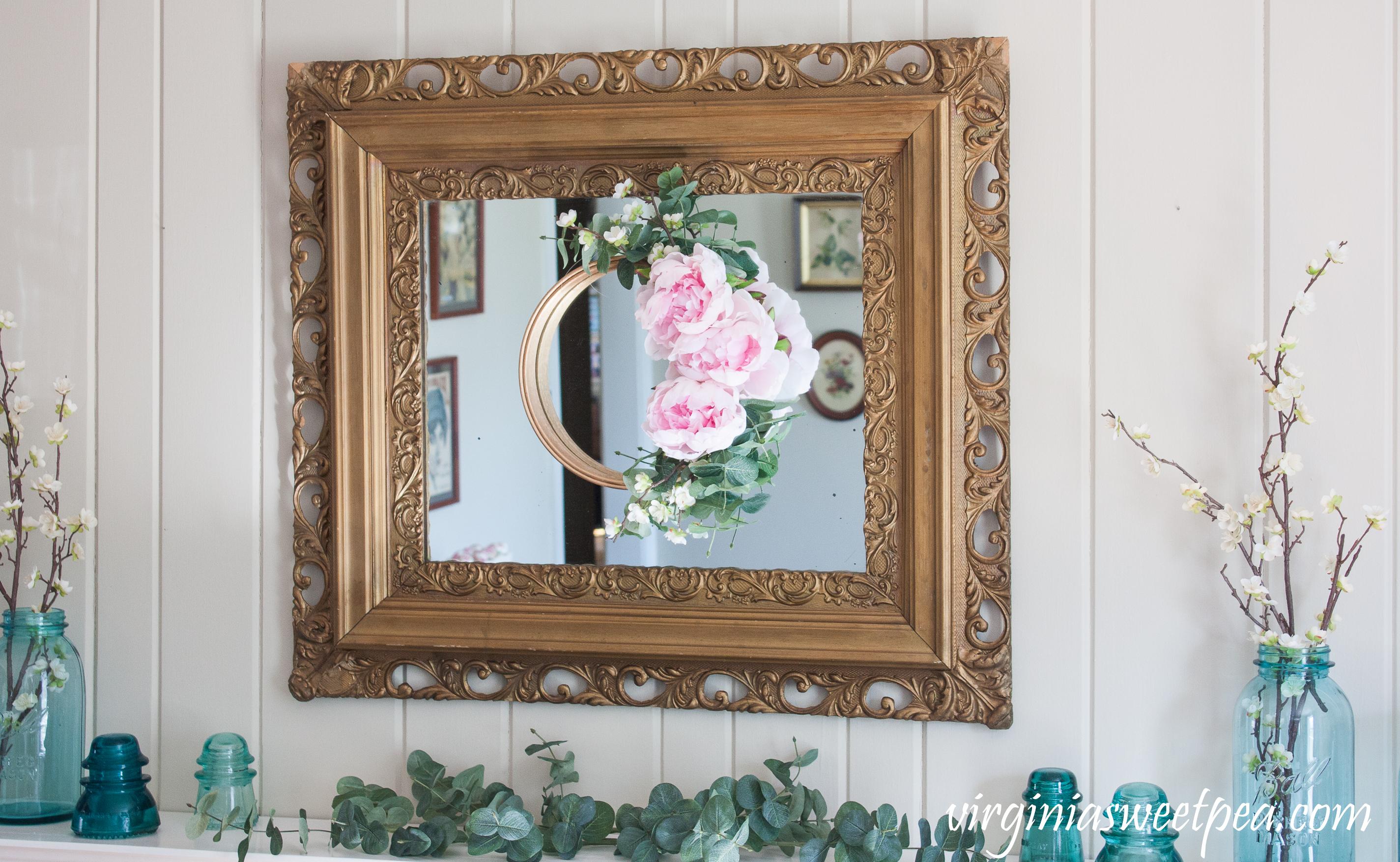 DIY Spring Embroidery Hoop Wreath - Step-by-step tutorial to make a floral embroidery hoop wreath for spring. #wreath #springwreath #wreathtutorial #springcraft