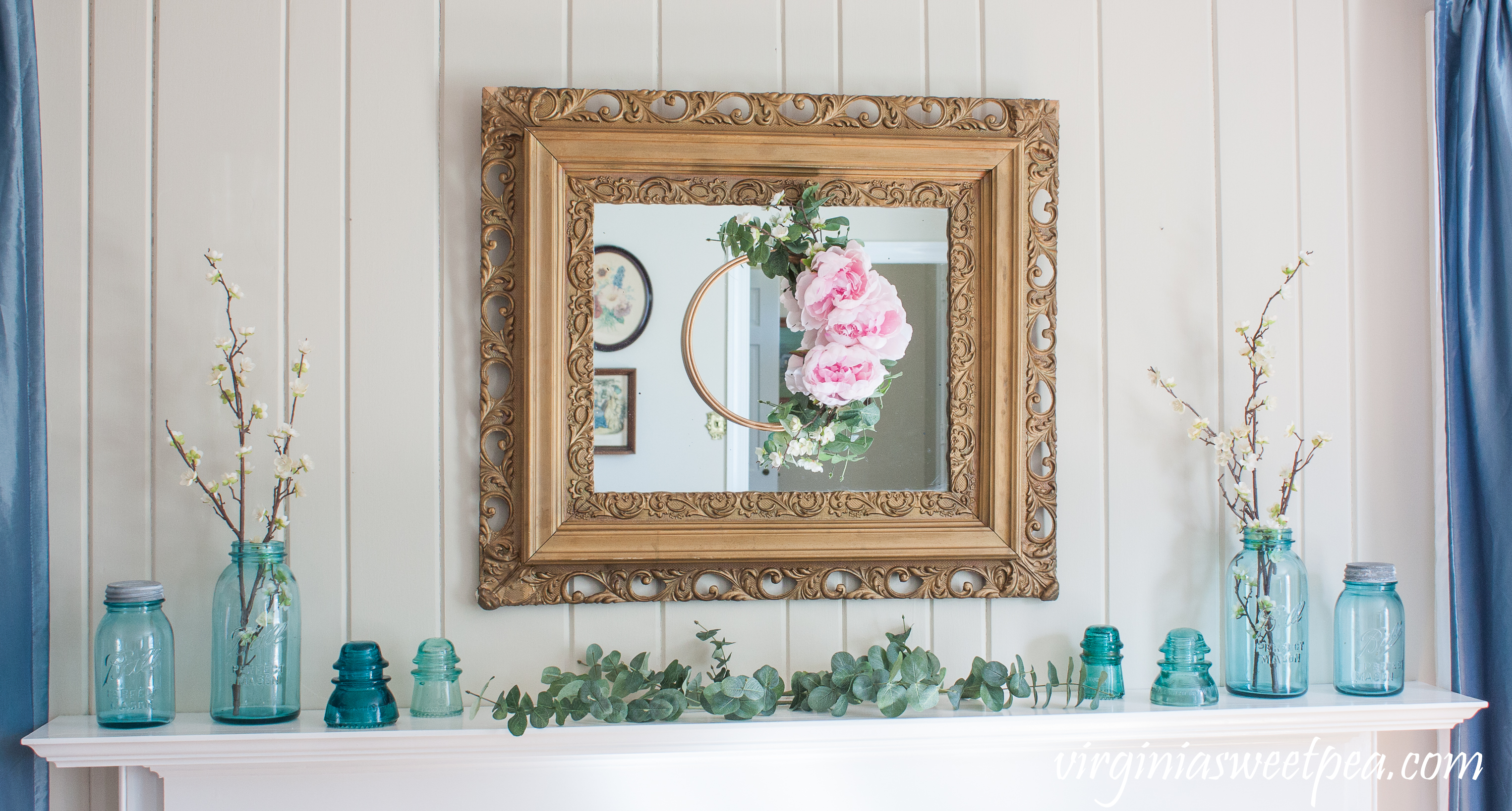 Spring Mantel and DIY Embroidery Hoop Wreath - A mantel is decorated for spring with vintage blue Ball jars and insulators. #spring #springdecor #springmantel #wreath #springwreath #vintage #balljars #vintagedecor