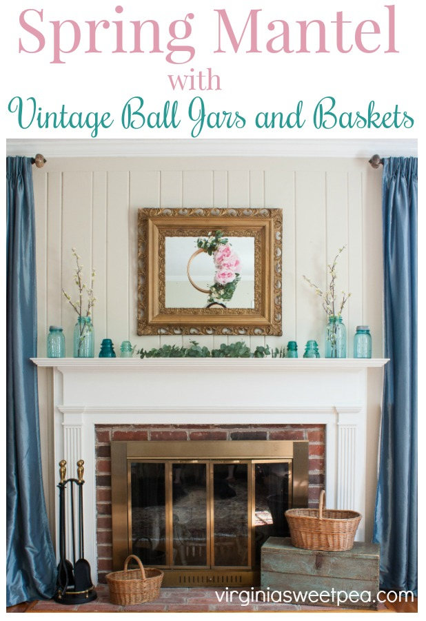 Spring Mantel with Vintage Balls Jars and Baskets - Decorate a mantel for spring with vintage ball jars, greenery, and a pretty spring wreath. #springdecor #springmantel #springdecorating #vintage #vintagedecor #balljars