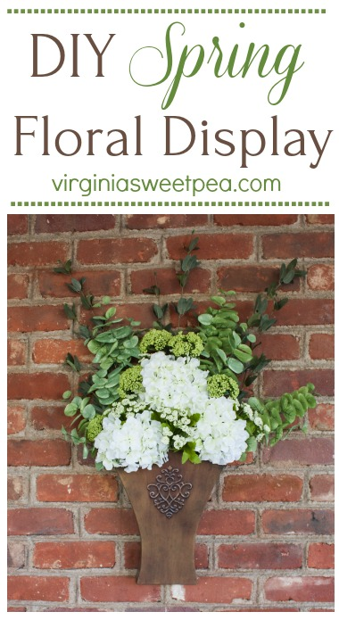 DIY Spring Floral Display - Learn how to make a floral display like this to display in your home. This would look great hanging on a door or on a porch wall. #springdecor #springfloralarrangement #springwreath #springdecorating