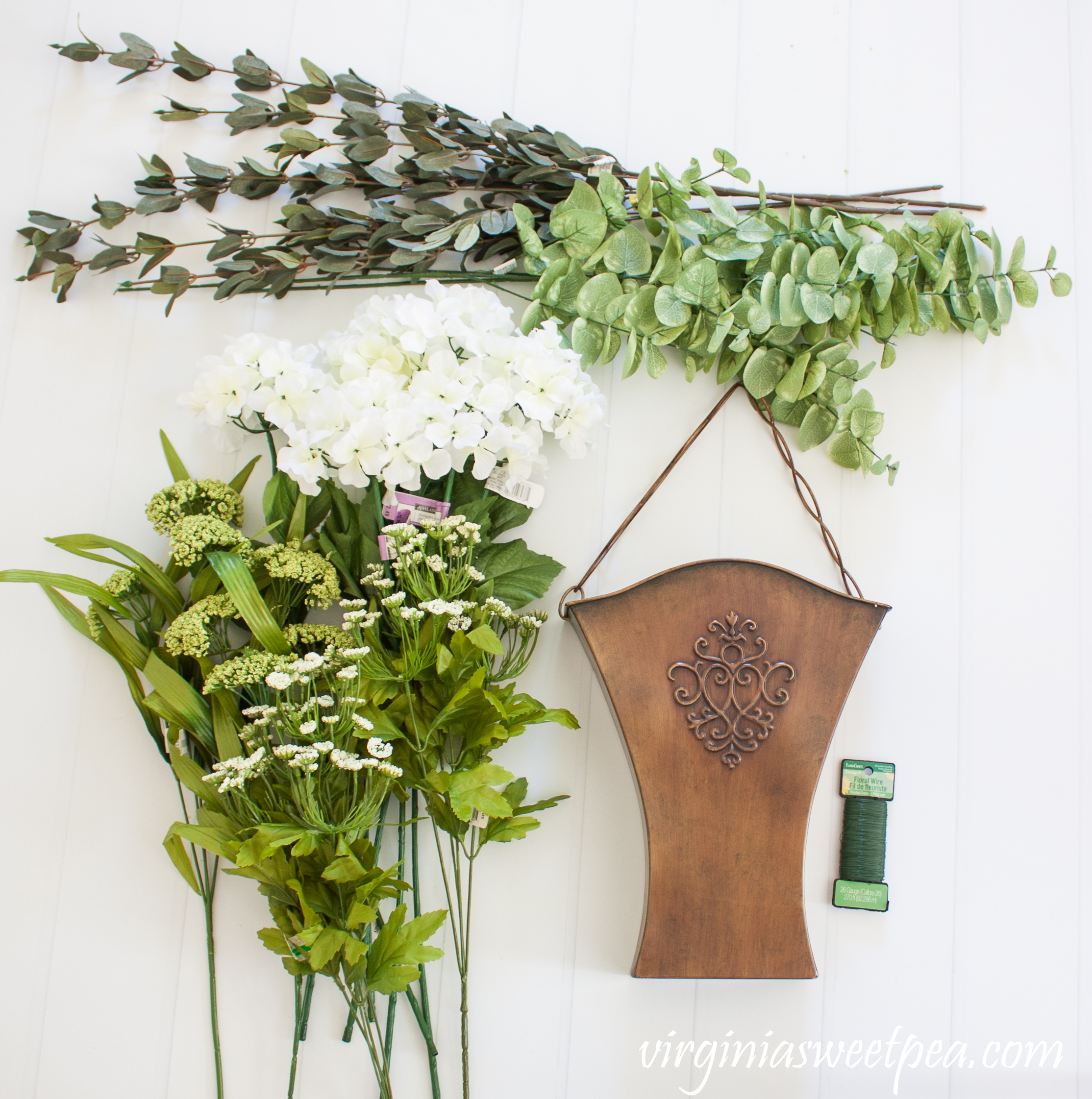 Supplies to make a hanging spring floral arrangement