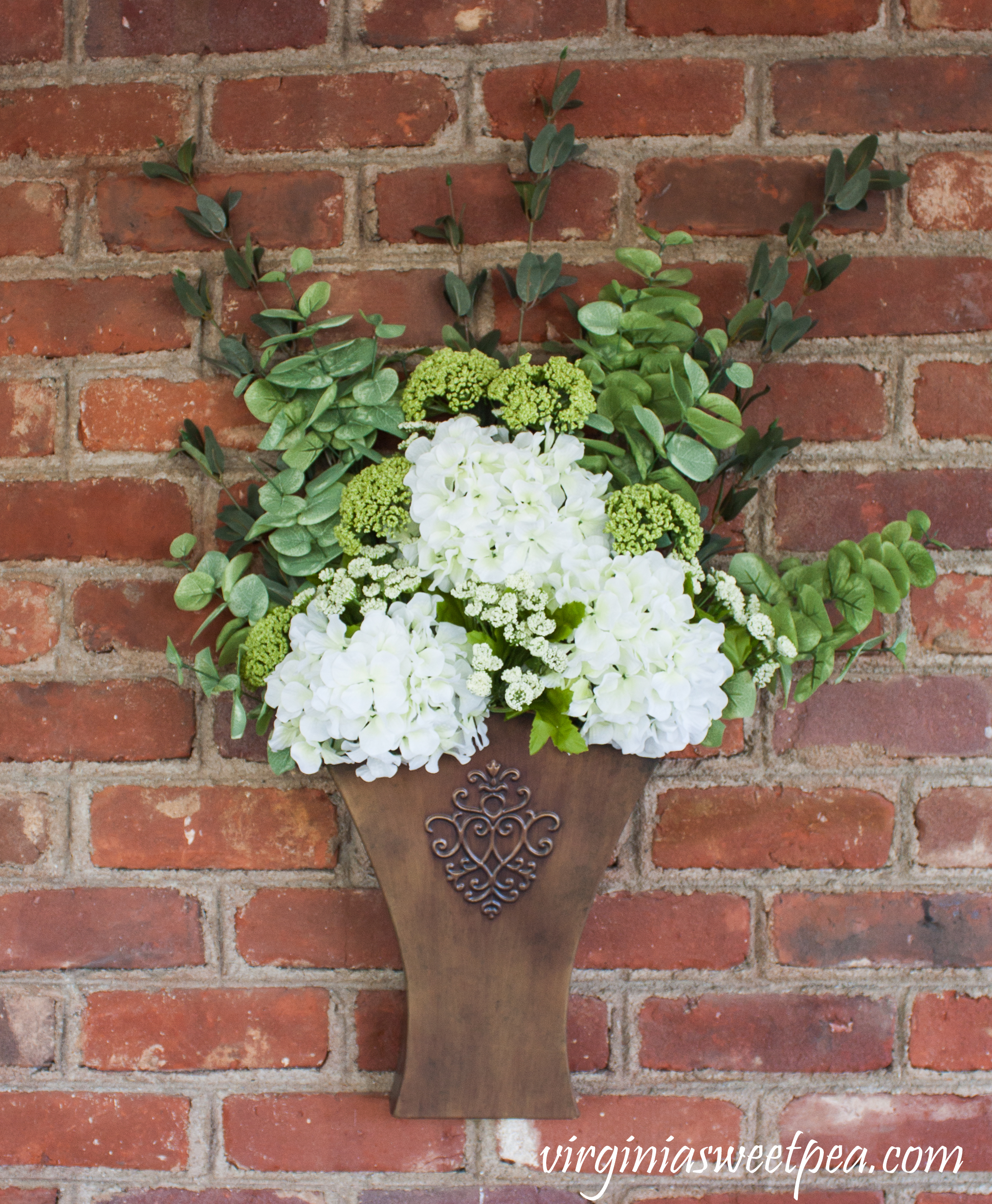 Floral Arrangement in a Southern Living at Home Willow House Flower Market Door Bucket