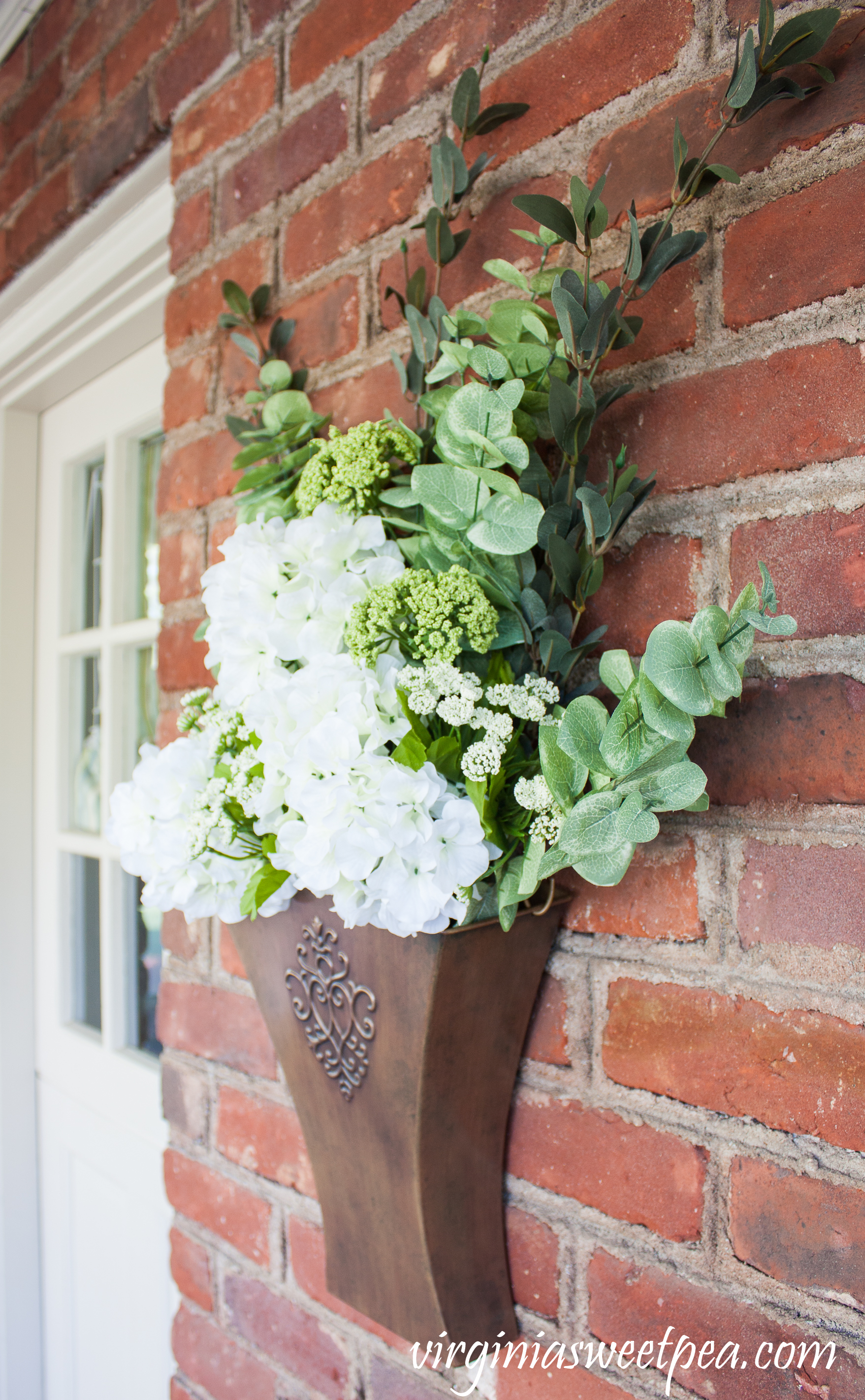 Spring floral arrangement in a Southern Living at Home Willow House Flower Market Door Bucket