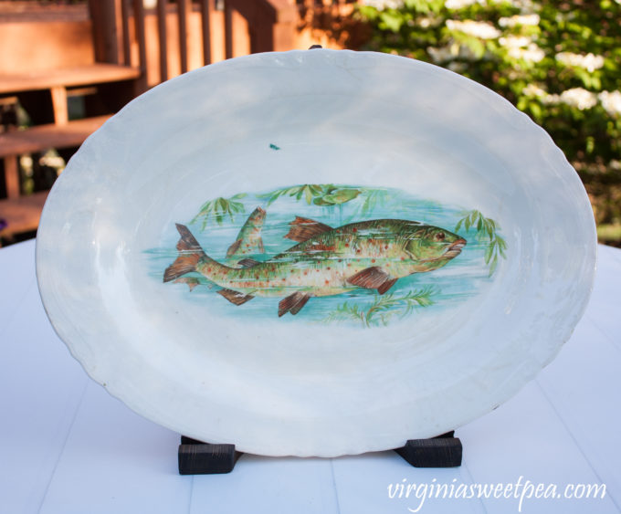 Antique fish platter displayed using a DIY wood display stand