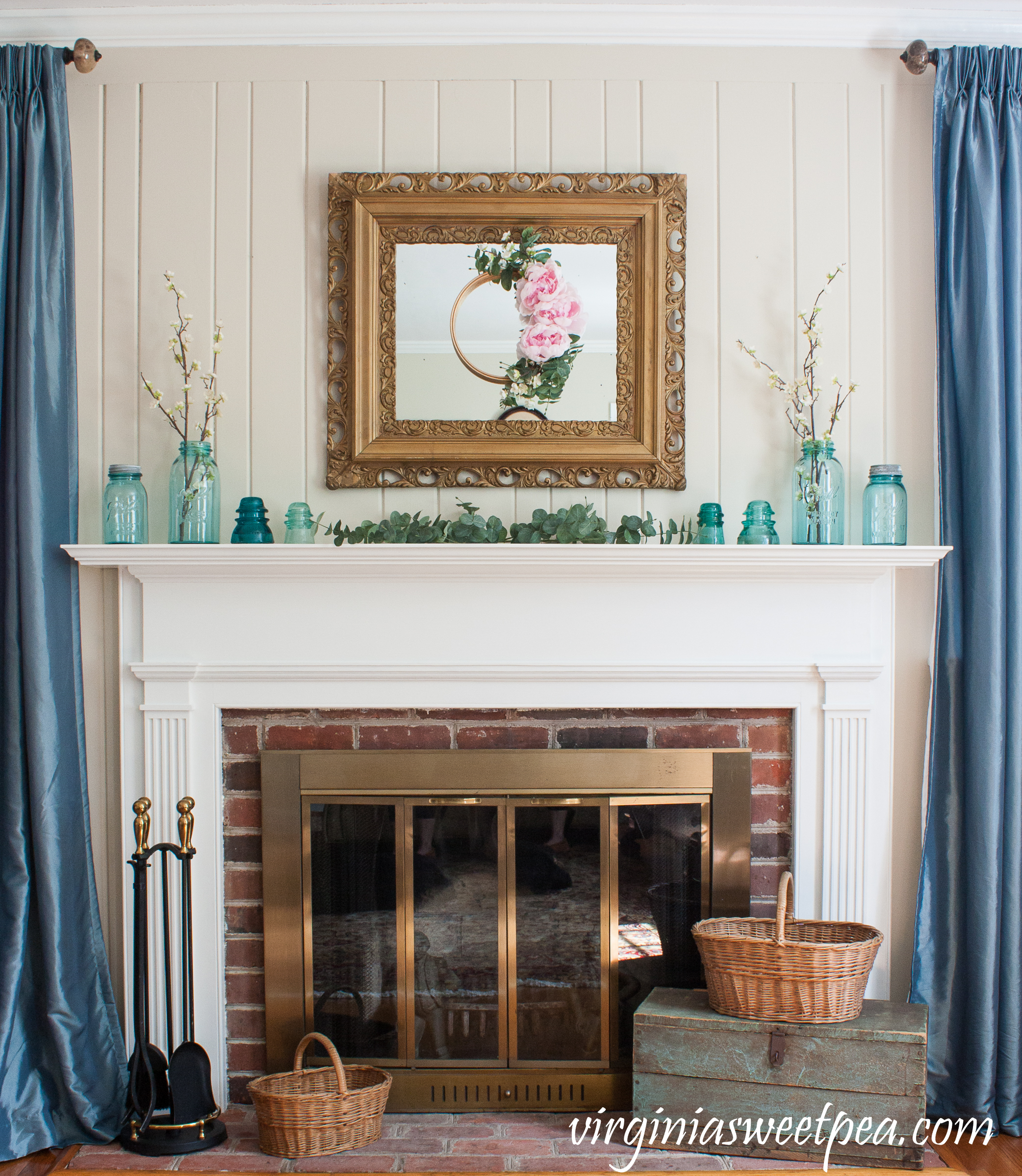 Spring Mantel with Vintage blue Ball Jars, Insulators, and Baskets - #springmantel #springdecor #vintagedecor #vintage #antiquebaskets #vintageddecor