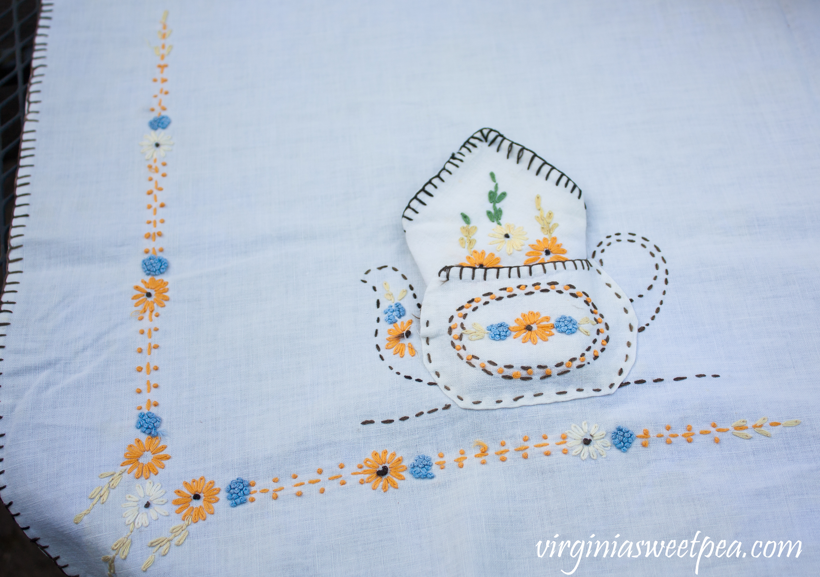 Embroidered Tablecloth from the early 1930's featuring tea pots.