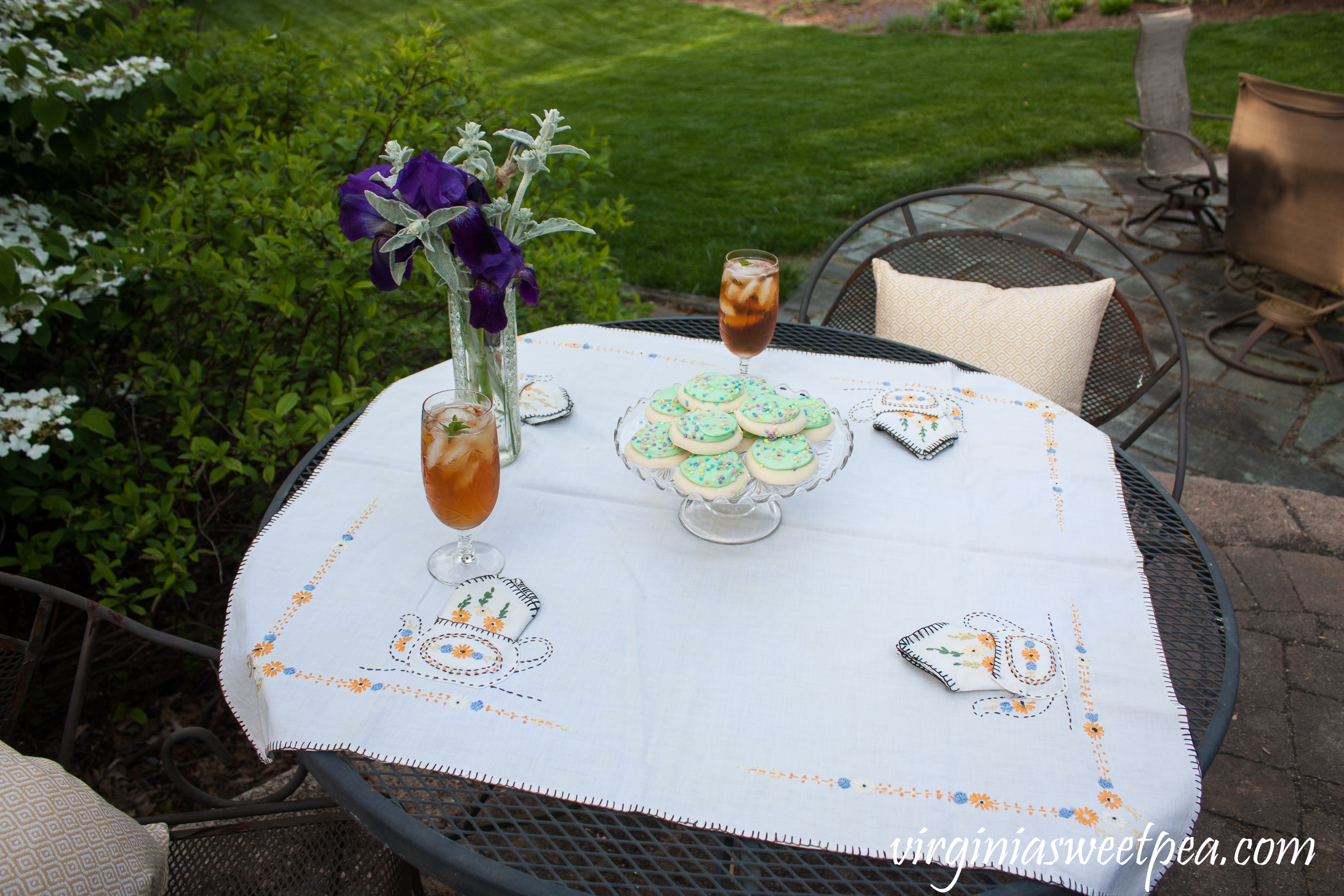 Spring Tea Party featuring a tea party themed embroidered tablecloth from the early 1930's.