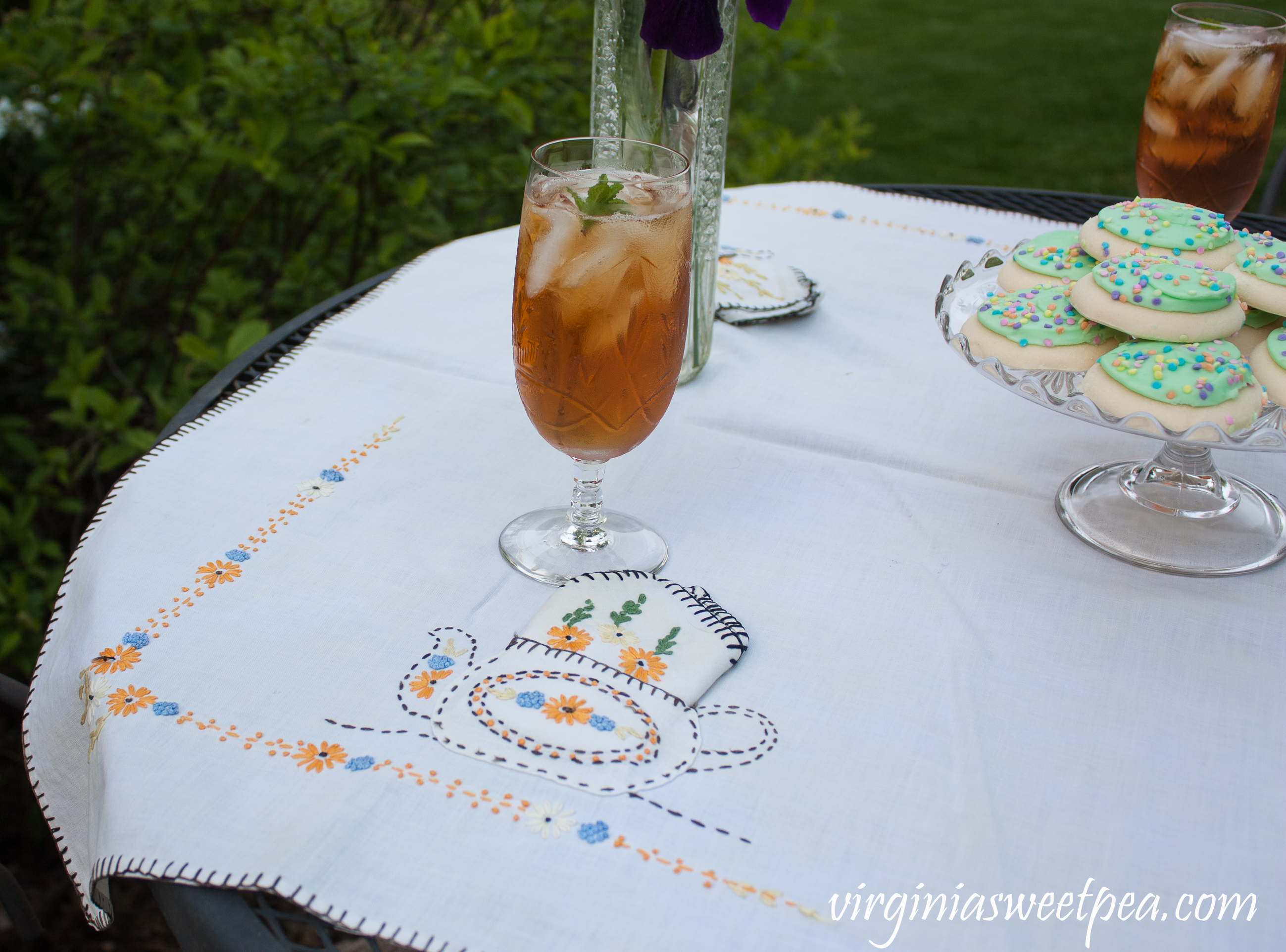 Villars by Rock Sharpe crystal with a 1930's tea party themed embroidered tablecloth