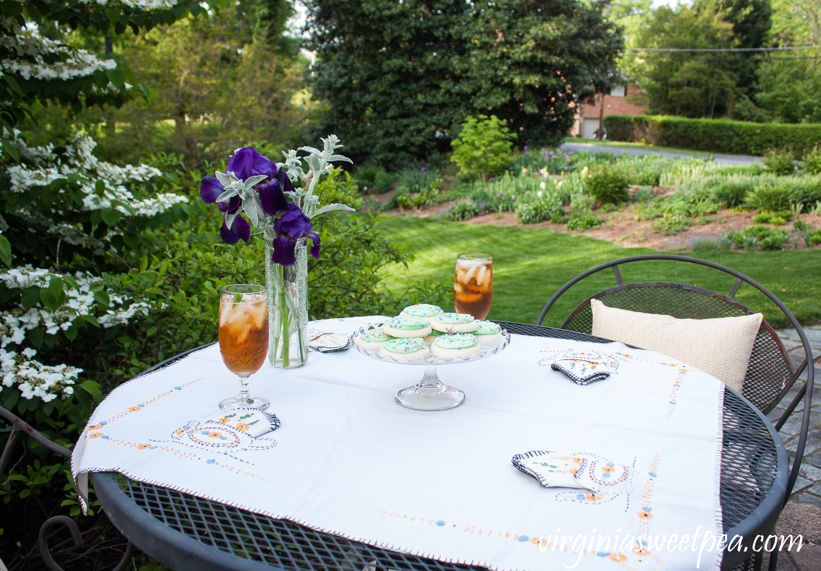 Spring Tea Party in the Garden with Vintage featuring a depression era tablecloth, crystal, and cake server.