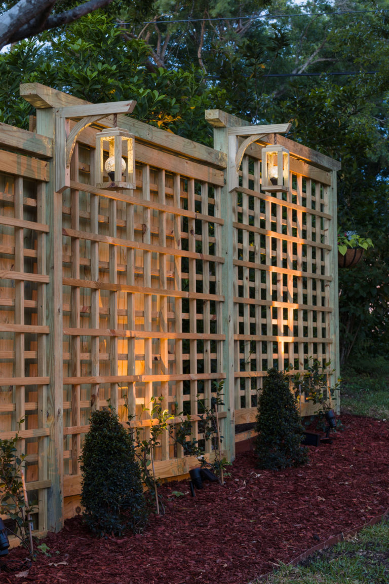 DIY garden screen trellis with DIY hanging lanterns