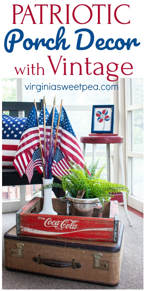 Patriotic display on a porch featuring vintage and red, white, and blue