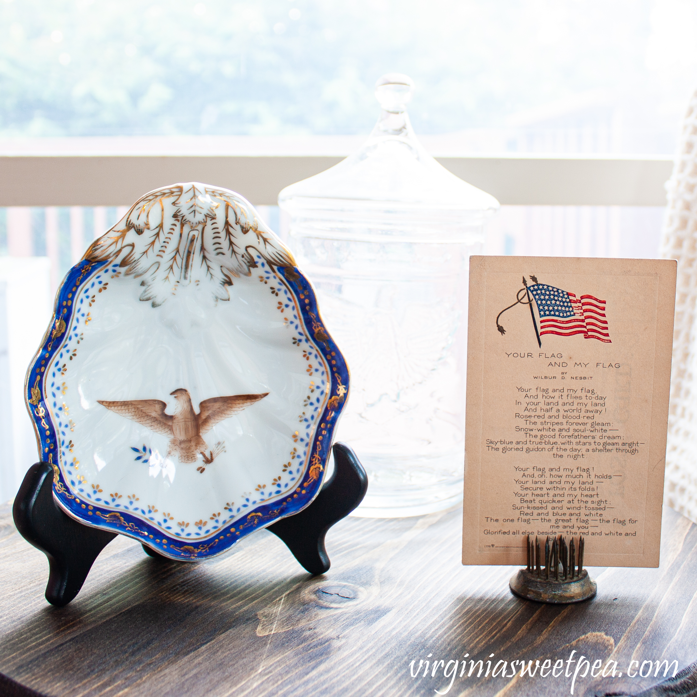 Vintage china bowl with an eagle and a vintage flag postcard