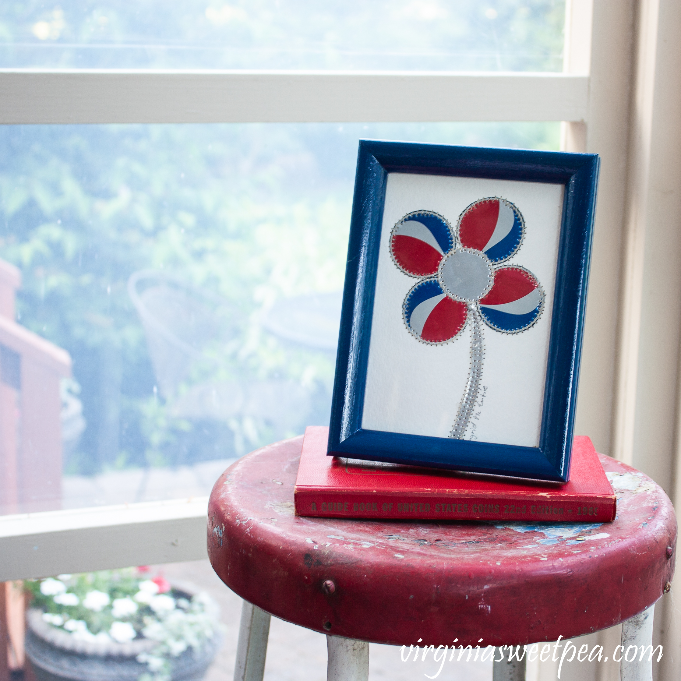 Patriotic card with a flower made from cut up Pepsi can pieces