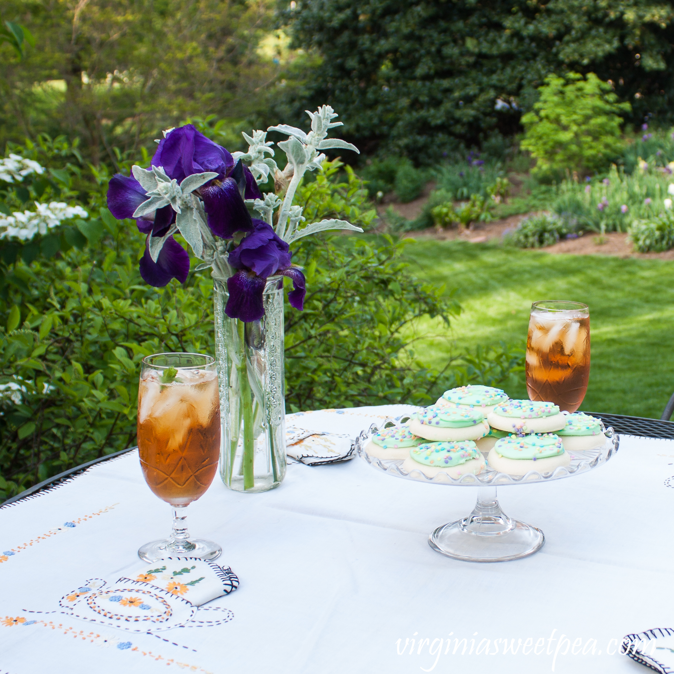 Spring Tea Party with Vintage - A garden tea party includes a table set with vintage crystal, a vintage cake stand, and a tablecloth from the early 1930's.