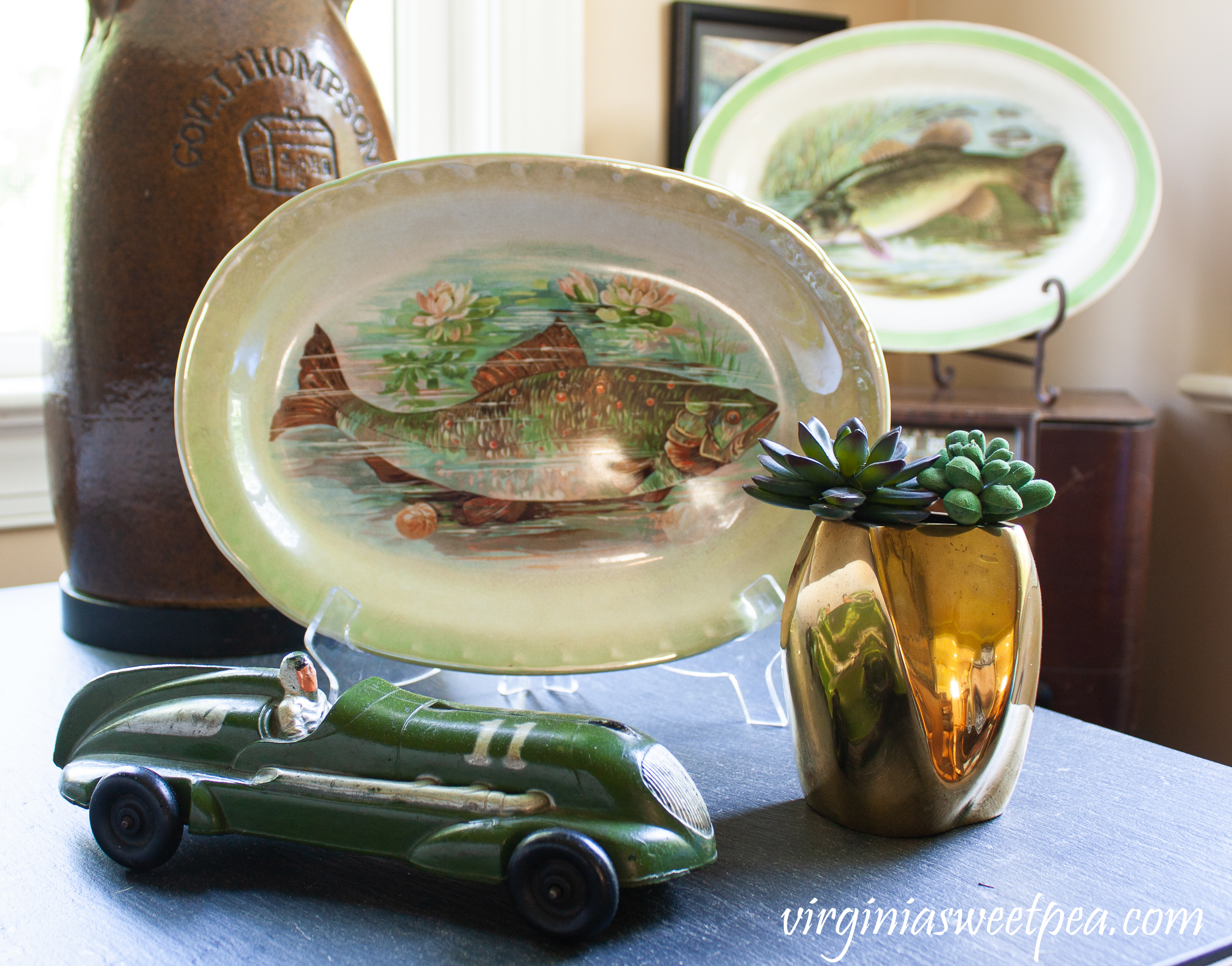Fish themed summer vignette with a 1940's toy car.