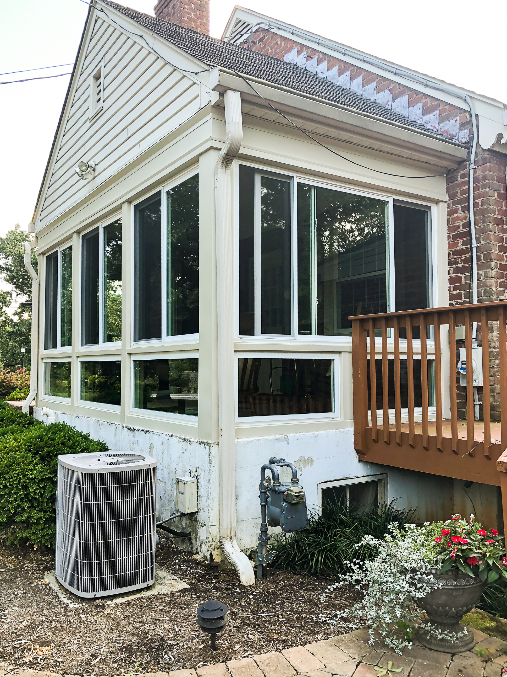 A screened porch is transformed into a sunroom. Before and After pictures.