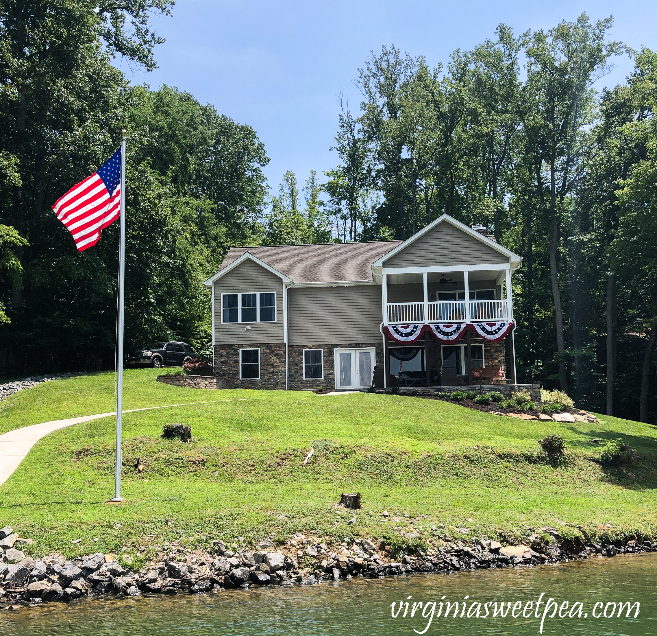 House at Smith Mountain Lake, Virginia with flagpole in the yard