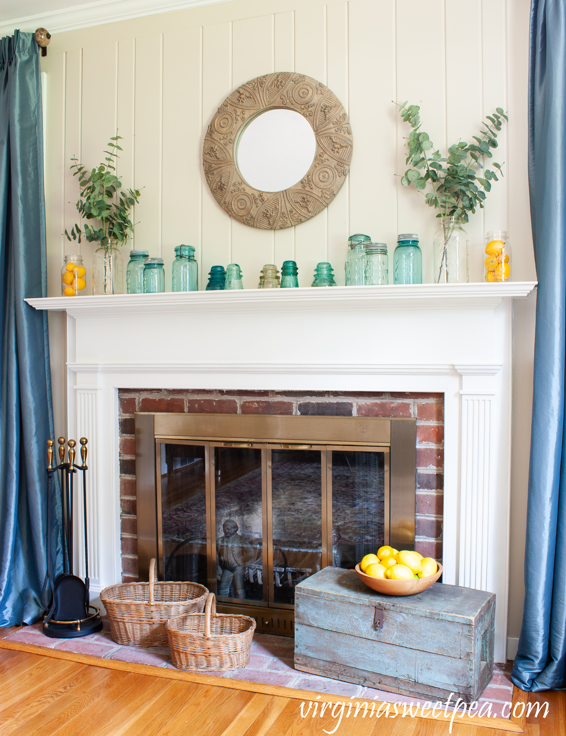 Summer mantel with vintage mason jars, lemons, and eucalyptus.