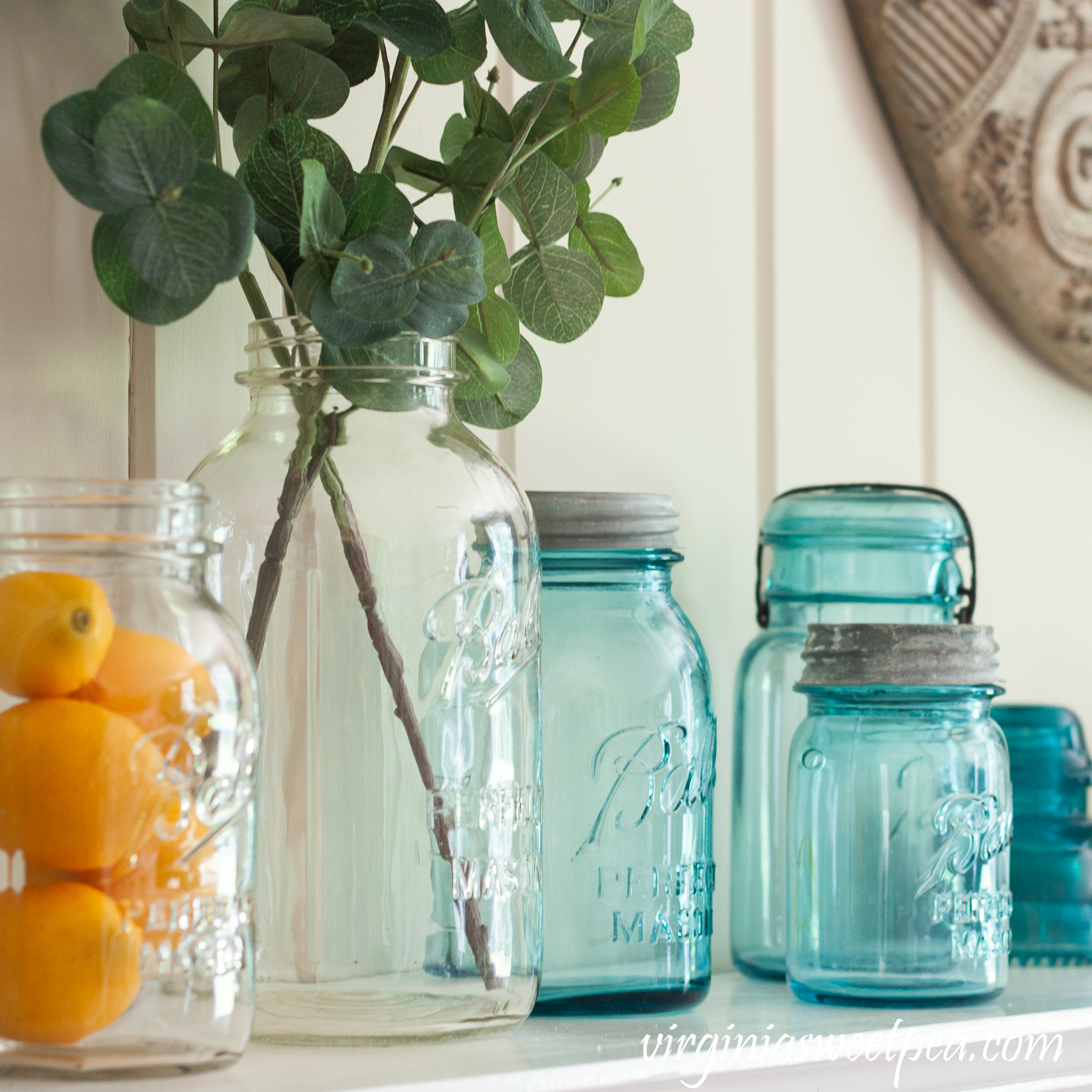 Vintage Ball Perfect Mason jars used on a summer mantel with lemons and Eucalyptus.