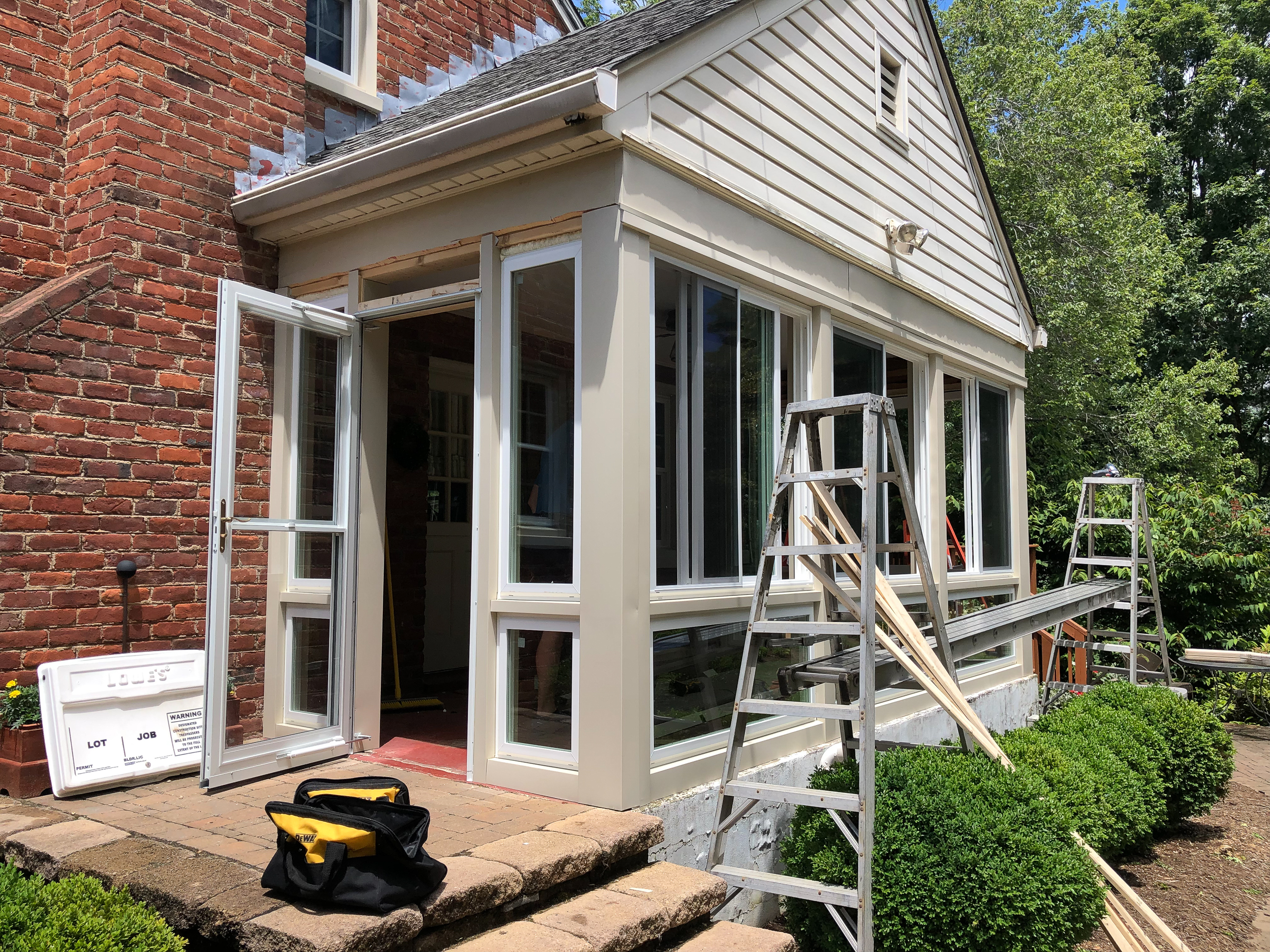 Converting a screened porch to a sunroom. Progress photo of the project.