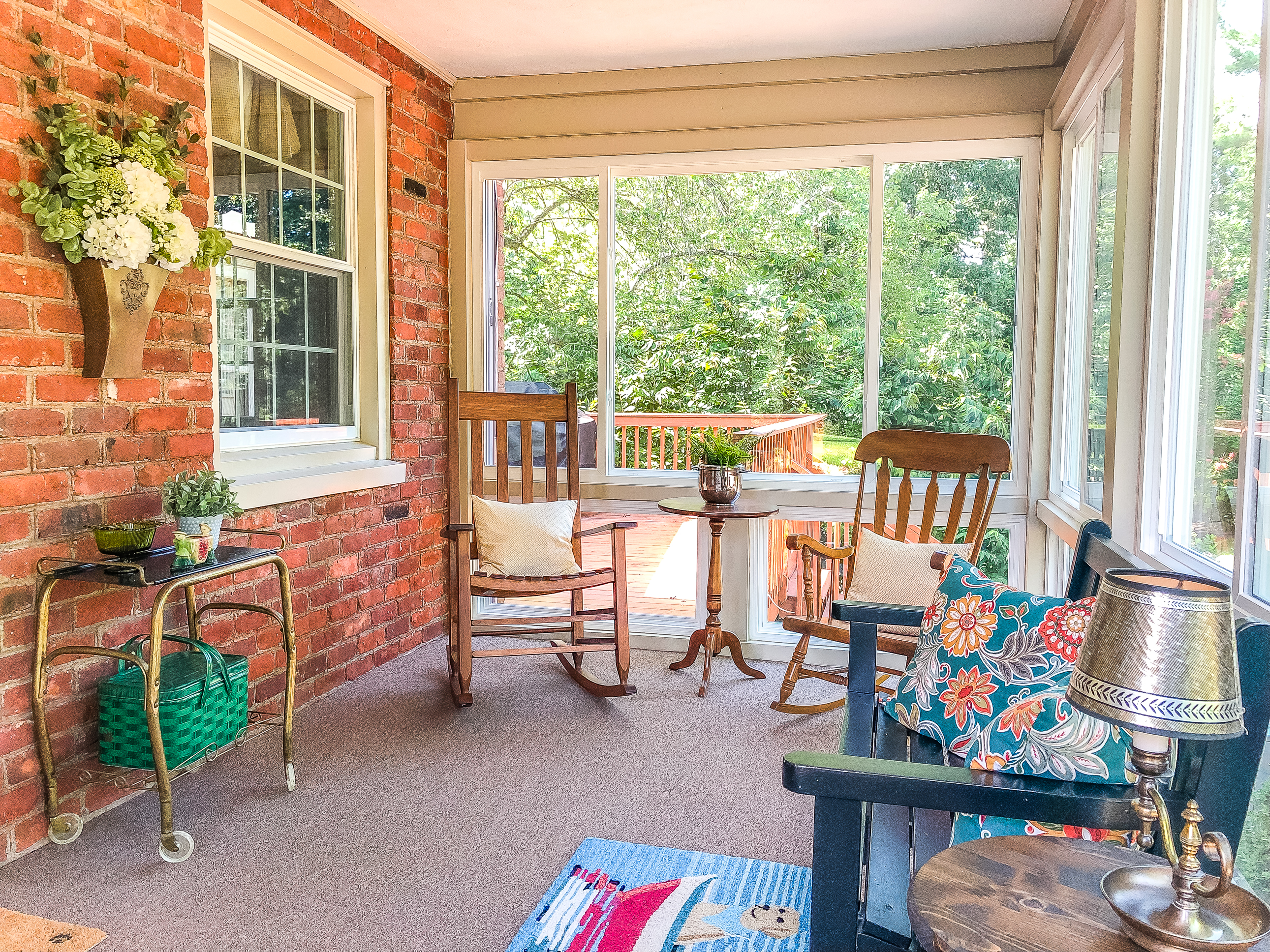Interior pictures of a screened porch converted to a sunroom.