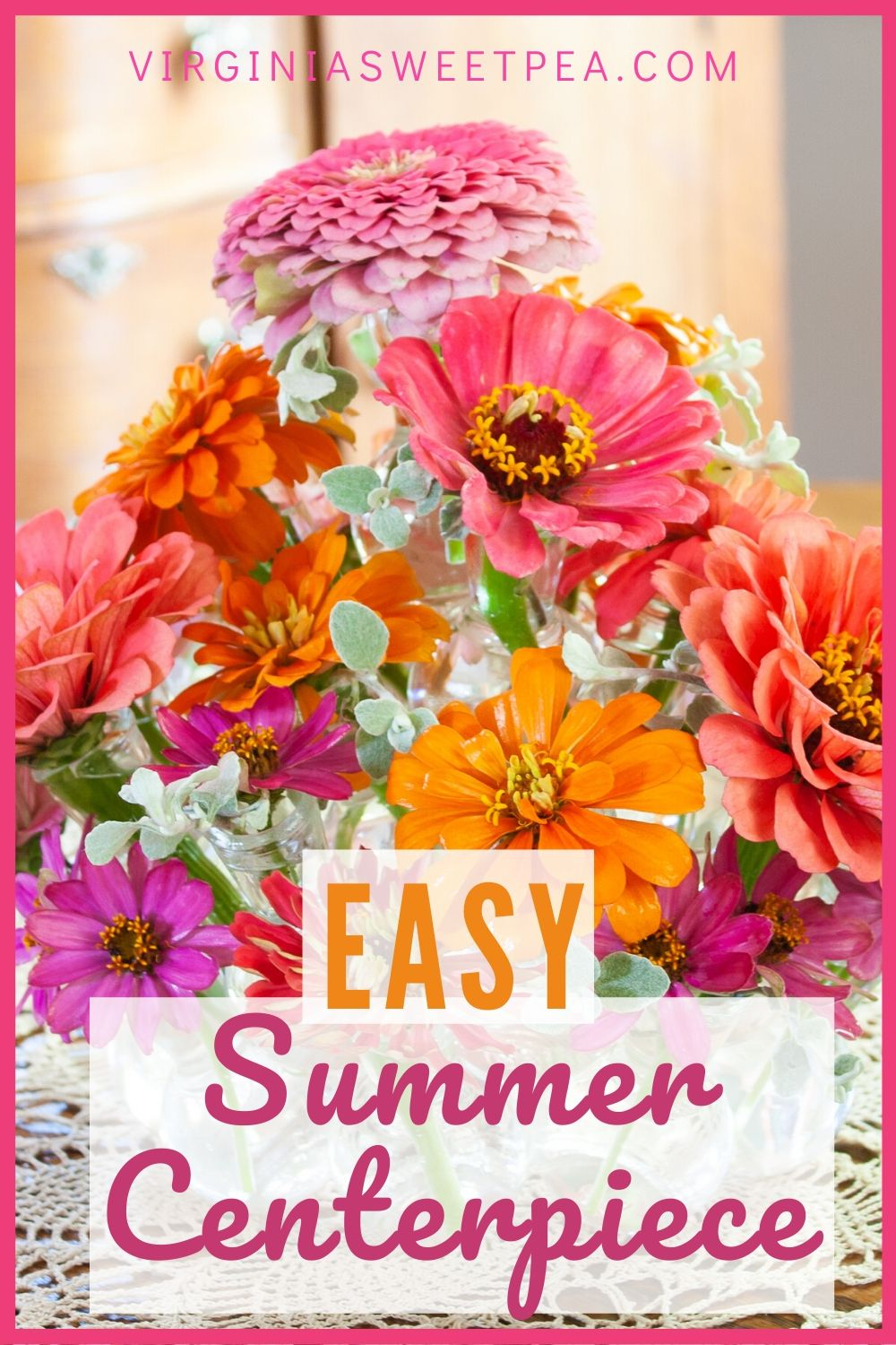 Easy Summer Centerpiece - Making a summer centerpiece for your table is simple with this easy way to arrange flowers. No floral design skills are needed to make this centerpiece. The same method can be used to make a centerpiece in any season. #centerpiece #summercenterpiece #zinnias #flowerarragement via @spaula
