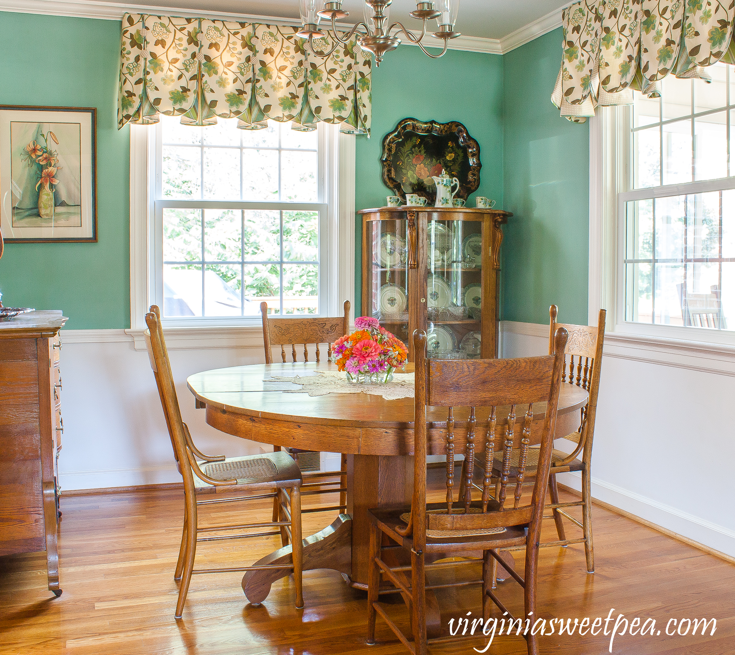Dining room decorated with antique oak furniture.