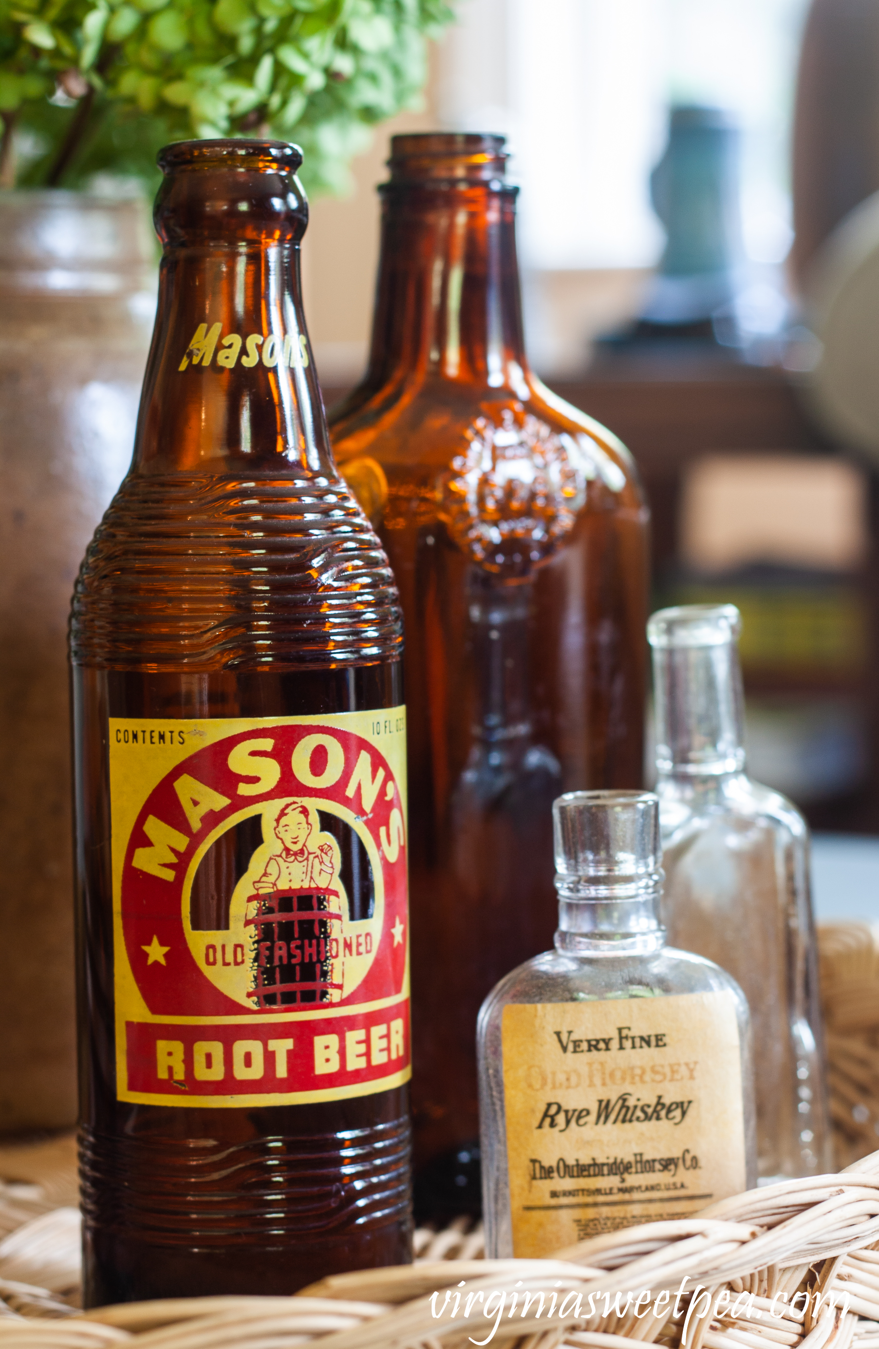 Mason's Root Beer bottle, Very Fine Old Horsey Rye Whiskey bottle, a brown liquor bottle and a small clear glass bottle.