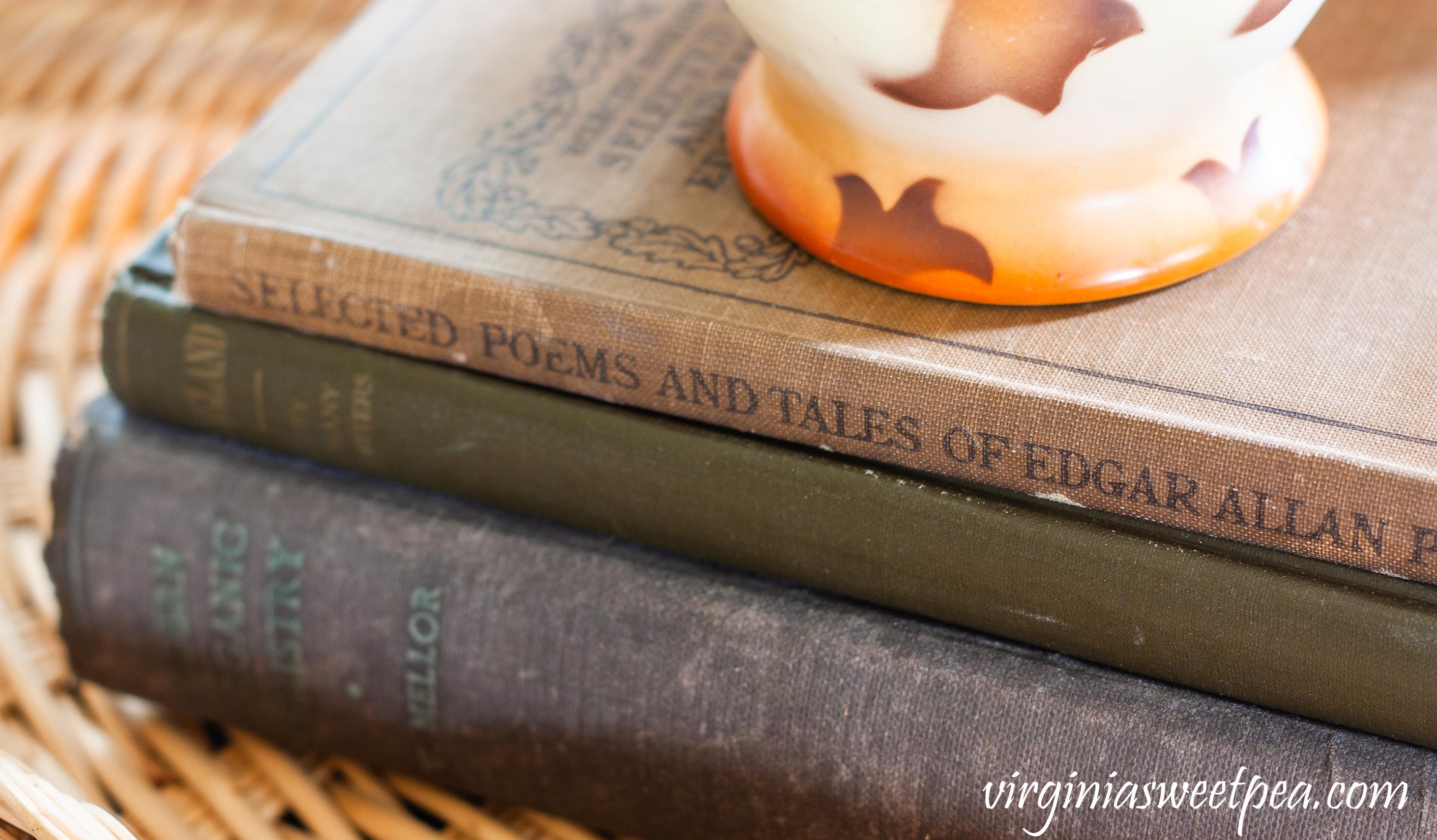 1914 Edgar Allen Poe book, 1906 England book and a 1918 Modern Inorganic Chemistry book.