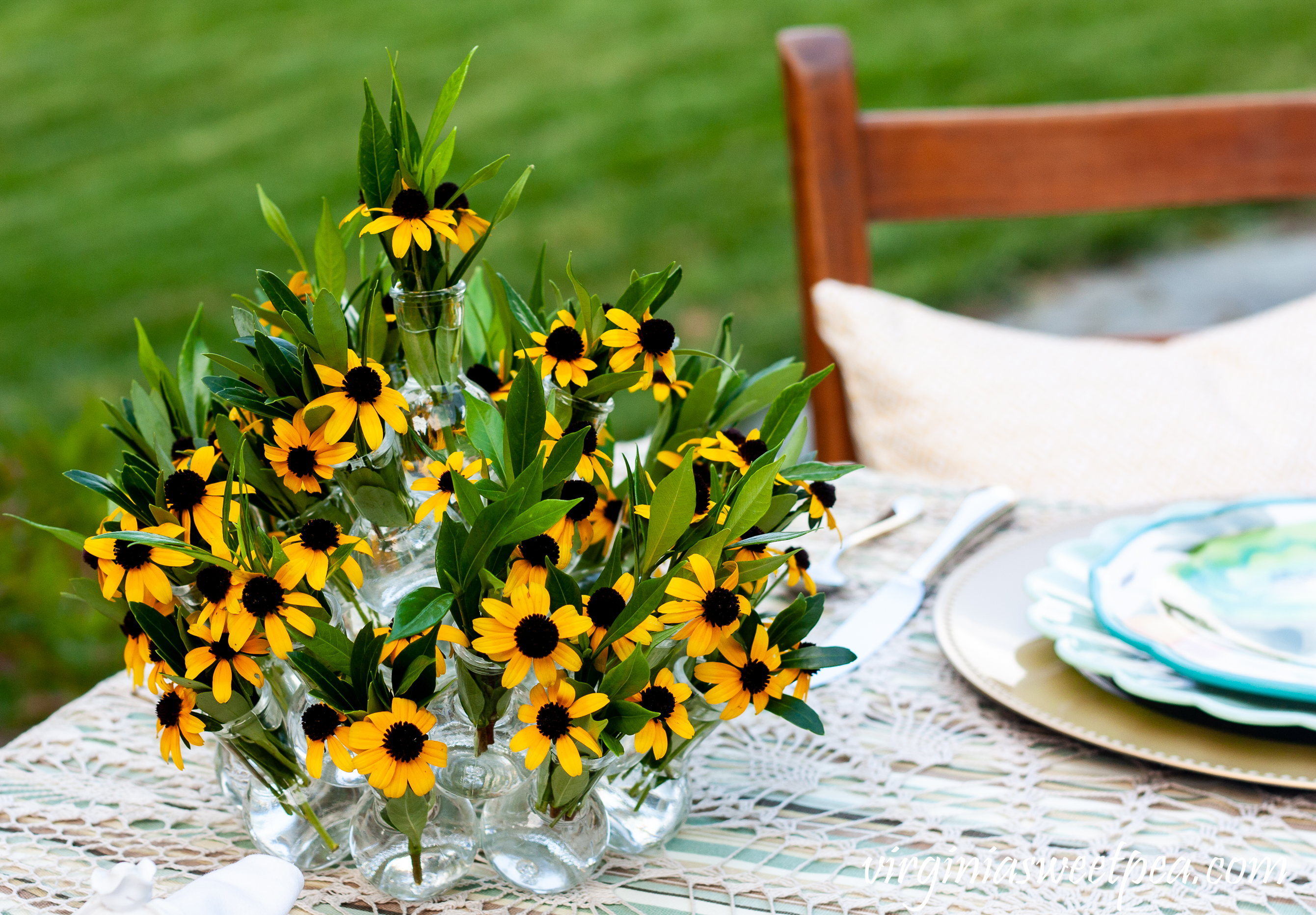 Summer table centerpiece with Rudbeckia and Gardenia foliage