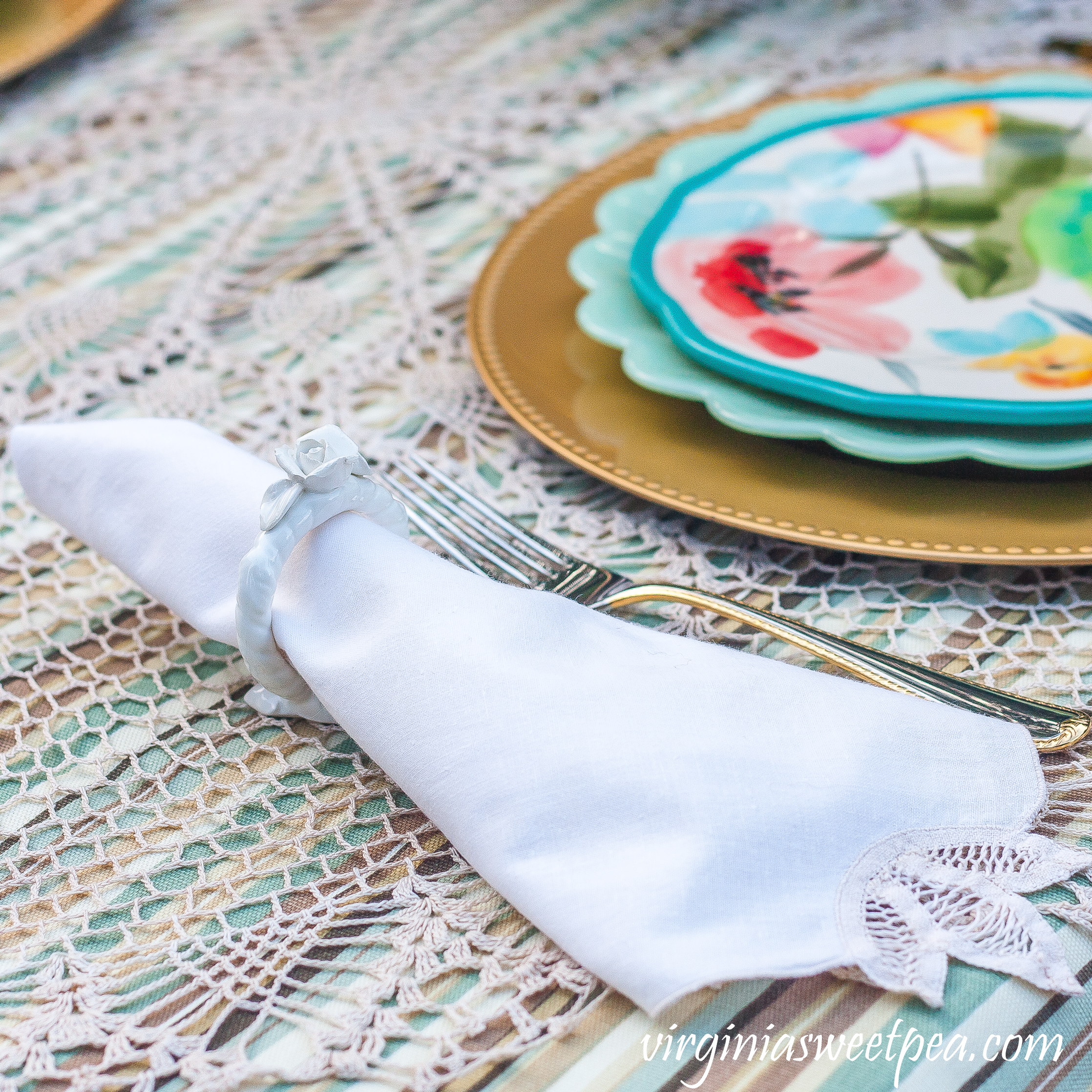 Napkin with cut lace in a floral napkin ring